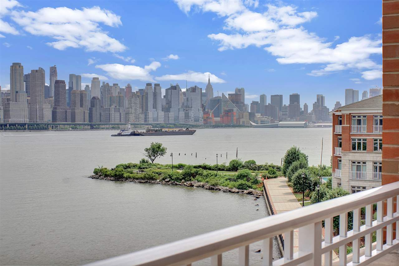 Enjoy direct East views in this sun drenched 3 Bedroom / 3 Bathroom duplex located in prestigious Hudson Pointe. Stretching across 1,393 SqFt, this home features hardwood floors throughout, a chef's kitchen with Viking appliances and granite counter tops, separate dining area, and a large balcony with stunning views of NYC and the Hudson River. Master bedroom features large walk in closet and en suite bathroom with double vanity sinks. Second bedroom and loft allow for plenty of space and storage. Hudson Pointe features 24 hour doorman, fitness center, outdoor pool, business lounge, and movie theater. With two car garage parking and easy access to NYC, this is truly a place you'll want to call home!