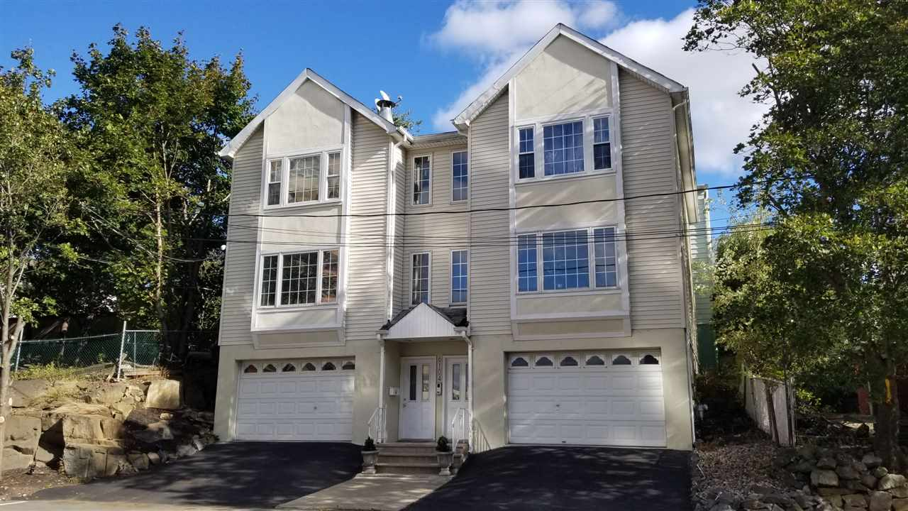 Rare duplex in prime location with upgrades throughout home. Great for homeowners and investors alike. Hardwood floors, granite countertops, stainless steel appliances, open layout 1st floor, master bed with master bath on 2nd floor, 4 parking spaces available, close to bus stop to NY & all major highways