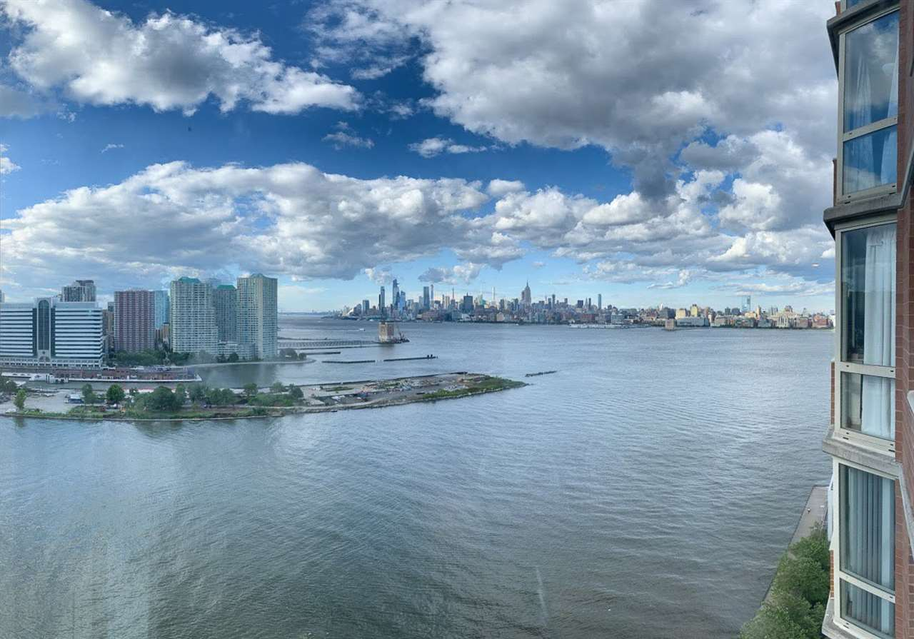 Enjoy unobstructed spectacular Hudson River and mid-town Manhattan views from this 21st floor condominium which features in-unit washer/dryer, dishwasher, and walk-in closet. Residing within a full service, pet-friendly waterfront building with 24 hr concierge, gym, tot-lot, downtown Jersey City's largest outdoor swimming pool, plus patio/grilling area and clubroom/lounge with free WiFi. It has easy access to Newport Pavonia & Exchange Place PATH trains, Light Rail & Ferry. One parking spot is included in the price.