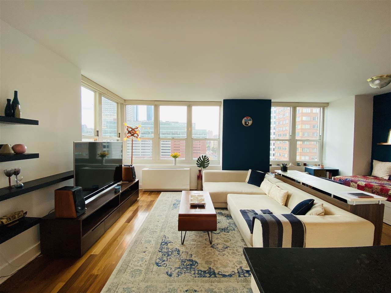 This corner unit is one-of-a-kind and rarely seen for sale.Conveniently located this gorgeous 837 SqFt 1 bedroom with appx. 670 SqFt Terrace offers gleaming hardwood floors, open kitchen design complete w/ cherry kitchen cabinets, granite counters, large breakfast bar, SS appliances, in-unit W/D, custom blinds, and lots of closets in bedroom w/the most amount of windows. The 08 line is the most sought after floor plan. Enjoy this huge terrace:get-together, a quiet afternoon overlooking the break through view and make your incredible own gardens. This Luxury lifestyle at the full service Trump Plaza Residences is known to the best amenities in Jersey City- 24 hour concierge, heated rooftop swimming pool, 8,000sq.ft fitness center, Spa, Virtual golf, Billiards room, Business conference center, and more; All walking distance to NYC transportation including the NY Waterway Ferry, PATH train stations, Light rail and buses. A commuter's delight! A must see!