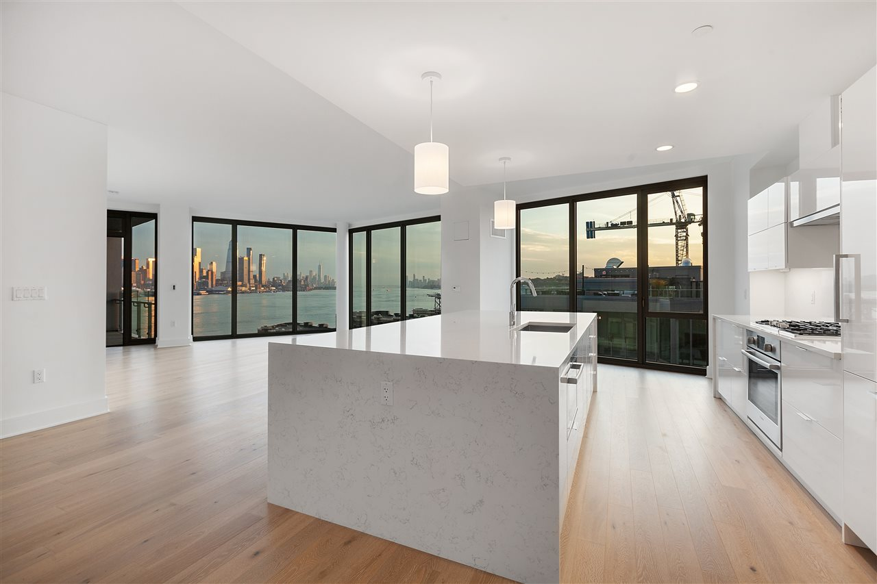This 2571 Square Foot 3 Bedroom Penthouse at Nine on the Hudson has an unbeatable Tax abatement, mind blowing view, TWO balconies, 40,000 Square Feet of Amenities, top of the line appliances and finishes, floor to ceiling windows, and an 8 minute ferry ride to Manhattan Hudson Yards via the Port Imperial Stop.  This is the premiere new development in West New York and easily one of the most spacious view units you can find on the market.  If you are interested in the best, I highly recommend you take a look at this.