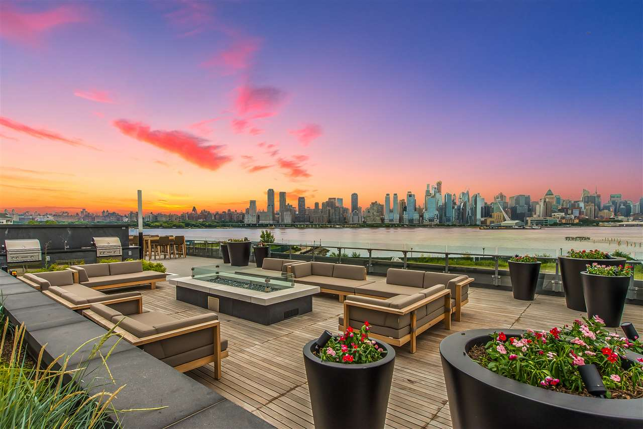As the most luxurious new construction on the New Jersey Gold Coast with breathtaking skyline views, incredible tax savings, and an 8 minute ferry ride to Hudson Yards in Manhattan, this apartment is not just a dream home, it is a smart buy. 2 spacious bedrooms, 2 baths, and a private balcony. The Chef kitchen has custom Italian Pedini cabinetry, expansive Aspen quartz stone countertops with waterfall edge, Bosch appliance package, and an over-sized Thermador built-in refrigerator. Floor-to-ceiling high-grade windows flood the apartment with light. The spacious bedrooms have ample closet space. Beautiful oak flooring runs throughout this modern dream home with Restoration Hardware lighting fixtures adding to its modern elegance. Opulent baths are finished with Carrera marble floors and walls, custom Italian Pedini vanity with a quartz counter top and Moen faucets and rain shower heads. Plus, quality washer and dryer are in unit. Enjoy exceptional resort-style amenities including 24/7 concierge/doorman, a resident lounge, custom infinity pool, 6000 sqft fitness center including a yoga studio, aerobic studio and weight room, 2 saunas, play area for our younger residents, community patio with fire-pits, bbq's, penthouse rooftop deck, wet-bar, entertainment room, building insurance, landscaping, trash removal and much more. You also receive a 20 year tax abatement! The first 10 years of taxes are 1.1% of purchase price.