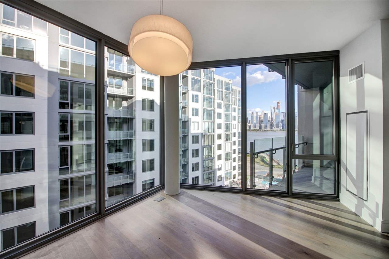 Nine on The Hudson - Discover the most premier and luxurious new construction building along the NJ Gold Coast. This beautifully designed luxury building features breathtaking views of NYC, resort-style amenities, and floor plans that fit even the most discerning buyer. This unit specifically is approx 1,489 SqFt with 2 Bedrooms + Den / 2 Bathrooms, North/Eastern exposure, balcony and garage parking. The expansive kitchen includes Aspen quartz countertops, Pedini cabinets, Bosch appliances, and Thermador fridge. Wood flooring throughout, in-unit washer/dryer, expansive closet space and oversized windows allowing for sunlight all day. The building features 24 hour doorman, state-of-the-art fitness center, amenity deck with infinity swimming pool and BBQ area, rooftop deck with cabanas, shuttle to/from Ferry, and a 20 year tax abatement program. First 10 years of taxes are 1.1% of purchase price! WOW...Welcome home to Nine on the Hudson!