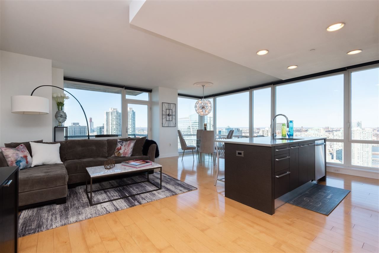Welcome to this luxurious 2 bedroom, 2 ½ bath condominium at Crystal Point, one of Jersey City Downtown's premier buildings with an exceptional location, leaving you just steps from the Exchange Place, Newport PATH trains, Harborside Light Rail Station and Ferry terminal.  The outstanding design of this open-concept floor plan is unbelievable. Let's start with the Chef's kitchen that comes fully equipped with state-of-the-art stainless steel appliances, a massive kitchen island complete with breakfast bar seating and ample custom cabinetry. A very spacious living and dining area, where the uninterrupted views of the Hudson River and the Mid-town Skyline from your floor-to-ceiling windows are breathtaking, and you will enjoy direct access to your private balcony, also ideal for al-fresco dining. The master suite also features floor to ceiling windows, a very spacious closet and an en-suite bath revealing a chic double vanity, a glass enclosed shower, and a lavish soaking tub. The second bedroom offers magnificent light and views, spacious closet, and sleek finishes and fixtures. Adding to these magnificent features you will also find a powder room and in-unit washer/dryer. Crystal Point offers unmatched amenities and services such as valet parking, access to the Crystal Spa (featuring a thermal bath, sauna, and steam room), movie room, play room, conference room, an expansive outdoor pool and an oversized terrace complete with fire pits, and gas grills. A yoga and aerobics room providing unrivaled services to aid in meditation and relaxation. Emerge yourself in the vibrant energy of Downtown Jersey City, reveling several assorted eateries and boutique shops. Don't miss out as this one is a must see!