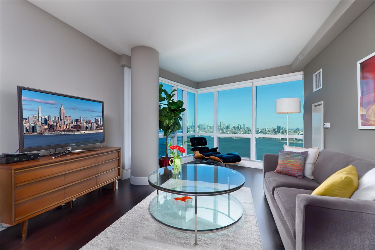 Breathtaking views abound in this rare to market,  Eastern facing, oversized 950sf 1 BR / 1.5BTH  home at 77 Hudson.   Views from a 1BR don't get much better than this in Jersey City: fully protected, panoramic, spanning a full 180 degrees from South/East/North including everything from the GWB to the Freedom Tower and Brooklyn.    This unique home served as a pied-a-terre for the original owner, has never been tenant-occupied, and remains in pristine, barely lived-in condition…  feeling and looking like brand new construction.   Features include European Kitchen with Carrara marble counters and Italian Dada cabinetry set against stunning dark African Wenge floors.   Luxurious and relaxing spa-like Master Bath with both Carrara marble and chiseled marble surrounding a deep soaking tub.   This trophy home comes with a convenient powder room, and plenty of closet space; including a large walk-in.   77 Hudson offers over 40,000 sf of resort-like amenities including landscaped rooftop with pool, state of the art gym, sauna, steam room, Pilates, complimentary yoga classes and more.  Prime Exchange Place/Paulus Hook location offers quick commute to NY with Path and Ferry at your doorstep.  One garage parking space is included.