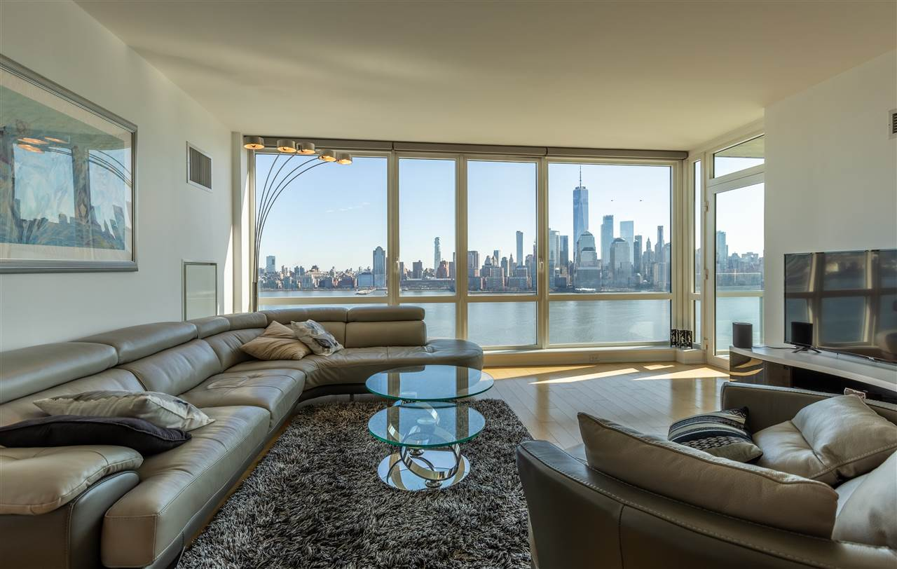 Jaw-dropping views! Welcome yourself to this amazing home, perched high above the city, on the 26th floor of the luxurious Crystal Point complex. Every inch of this home has been thoughtfully crafted to satisfy even the most discerning buyers. Experience the wonders of being located directly on the Hudson River waterfront, in this lavish home with unbelievable NYC & River views. Floor-to-ceiling windows frame the living area, sitting inside and looking out to the river, Downtown or Midtown Manhattan; or some outdoor time on your private terrace while marveling at the spectacular city. This unit features ultra sleek Kitchen with Pedini cabinets, glass accents, quartz countertops, tiled backsplash, breakfast bar and stainless steel appliances. The master bathroom features marble finishes throughout, double sink, ample storage and separate tub & shower. Additional features include gleaming hardwood floors, laundry closet & valet parking. Light Rail, PATH & ferry all in close proximity. Building features 24-hr concierge, pool, spa, fitness room, community room, outdoor deck with BBQ grills, kids play area & much more! Crystal Point offers one of the most attractive deals of any luxury building on the waterfronts: a tax abatement for the homeowners until 2040. Take advantage of this program as well as a low maintenance fee, while living in style and luxury at Crystal Point. As you arise each morning, enjoy incomparable views of the Hudson River and Manhattan Skyline from the grand master suite.