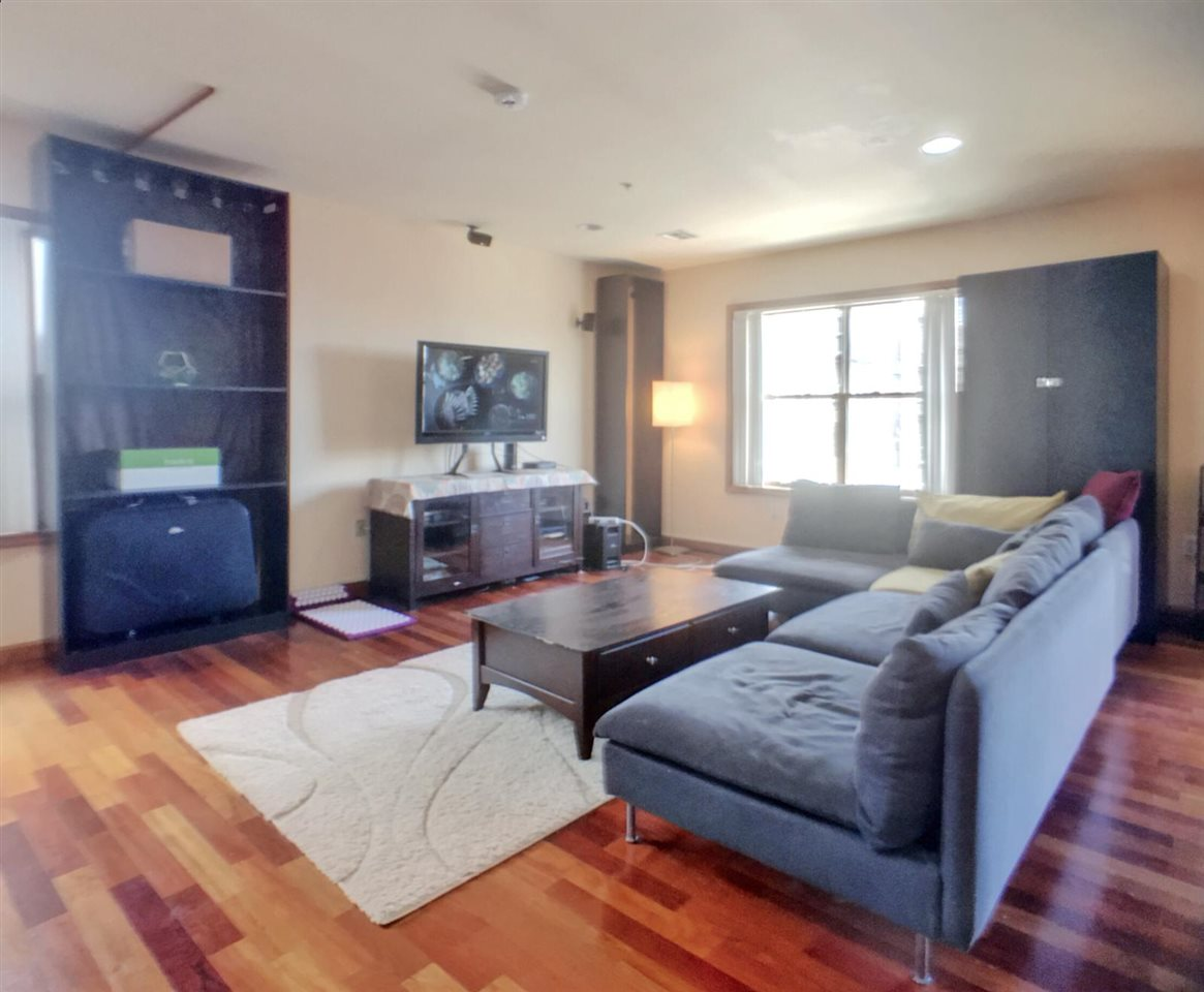 Luxury 2 bed 2 bath 1450 sqft condo rental with 2 CAR garaged parking included! Yes you read it right! 2 CAR PARKING!!  This home is just 350 yards away from light rail, check out the map in the pictures. Several buses to NYC Port Authority around the corner as well. This home is a corner unit with lots of natural light Cherry hardwood floors throughout, gorgeous French Juliet BALCONY off living room, luxurious granite countertops, recessed lighting, high ceilings, plenty of storage, WASHER/DRYER in unit, CENTRAL air/heat & video intercom system. Pets allowed on a case by case basis. Broker fees apply.
