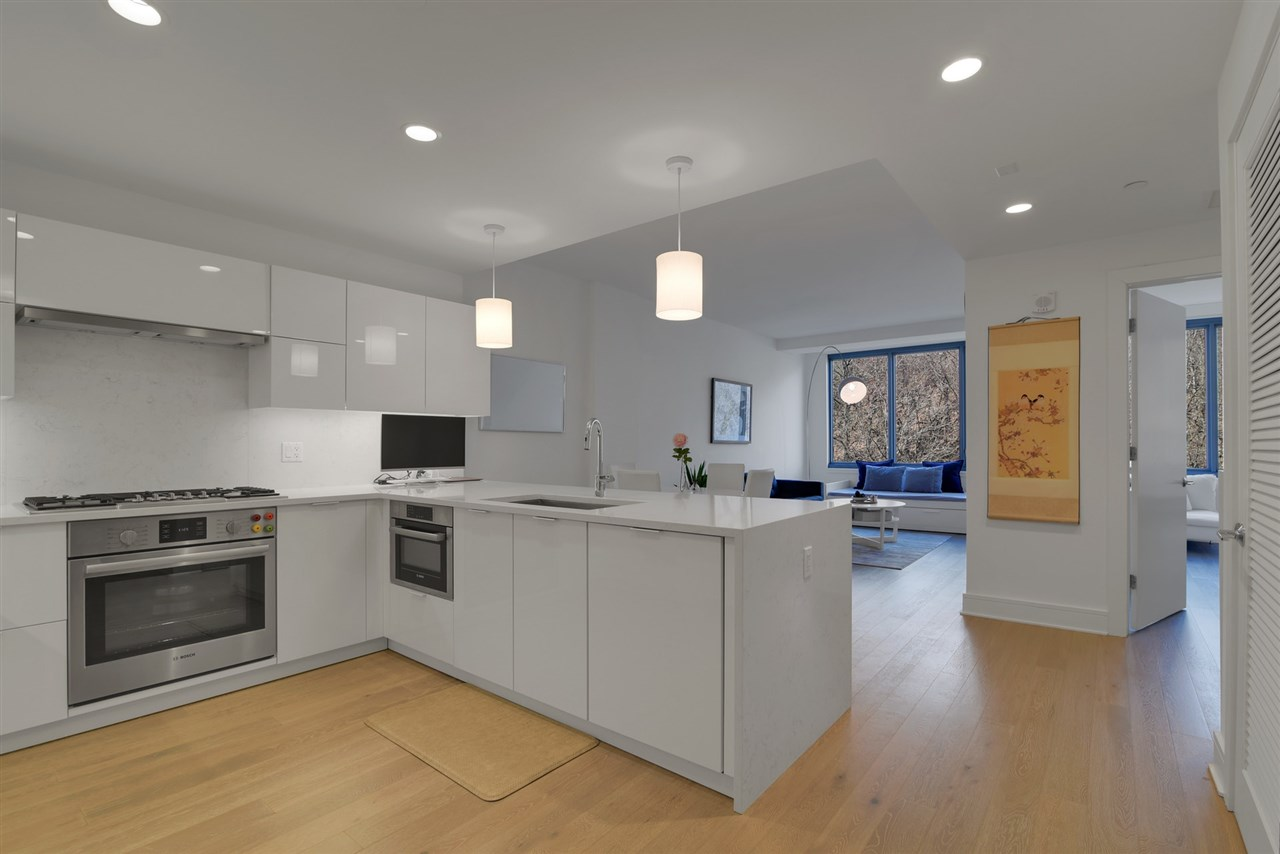 Discover pure opulence in the most premier and luxurious new construction building, Nine on The Hudson, located along the desirable NJ Gold Coast waterfront.  Walk into this spacious 1 bedroom, 1 bath, open layout floor plan covering approx 805 sqft with western exposure and garage parking!  The expansive kitchen includes Aspen quartz countertops, Pedini cabinets, Bosch appliances, and Thermador refrigerator.  The home also features wood flooring throughout, in-unit washer/dryer, walk-in closet space and oversized windows. This beautifully designed luxury building features breathtaking views of NYC with 40,000 sqft of resort-style amenities featuring 24 hour doorman, state-of-the-art fitness center, amenity deck with infinity swimming pool and BBQ area, rooftop deck with cabanas, shuttle to/from Ferry, and a 20 year tax abatement program that you don't want to lose out on. WOW...Welcome home to Nine on the Hudson!