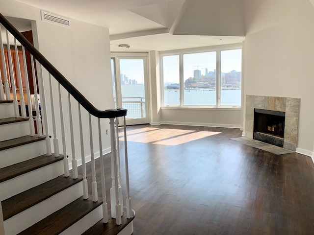 Beautiful condo on the waterfront offering over 1,500 SqFt. with stunning unobstructed south views of NYC and the Hudson River! This home offers three bedrooms with three full baths, wood burning fireplace and your own private balcony. Kitchen includes granite counters, stainless steel appliances and a pantry. Amenities include an indoor pool, fitness center, covered parking and 24 hour concierge. Convenient commute to NYC as the NY Waterway Ferry is next to the building along with NJ Transit bus stop across the street and the Light Rail is one block away! A Must See!!!