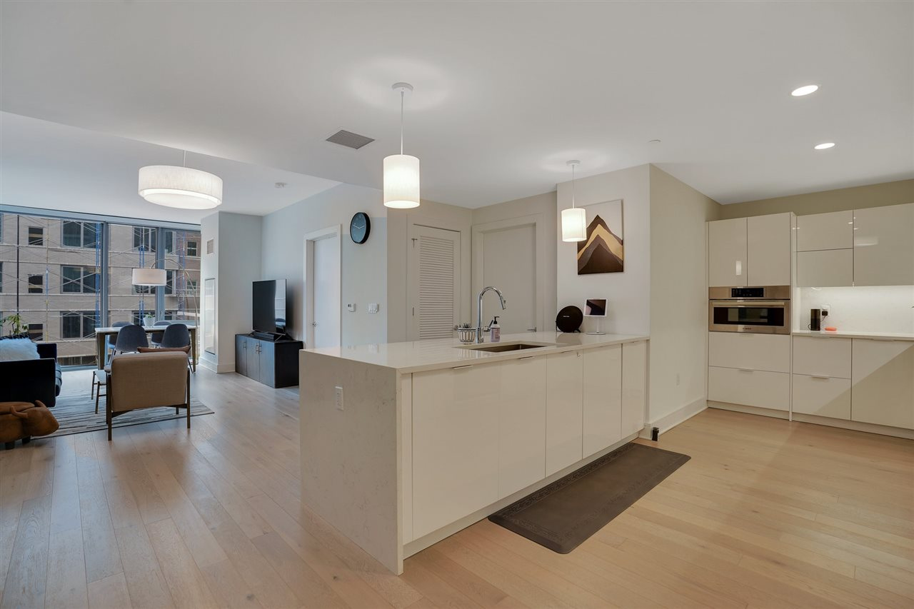 Nine on Hudson - most desirable new construction condos along the waterfront. 2bdr/2bth open floorplan offers floor to ceiling windows with south NYC skyline views . The interior details include wood floors, Pedini cabinetry, quartz counters, Carrera marble, Bosch & Thermador appliances. Unbelievable amenities include 24-hour Doorman service, state-of-the-art fitness center, rooftop deck,resident lounges, business center, kids playroom,pet grooming facility & a promenade deck with a infinity edge pool, lounge and BBQ areas. Walk to shops, restaurants & the ferry, Free shuttle as well tot he ferry The best PILOT program - in the area! there is a 20-year tax abatement program