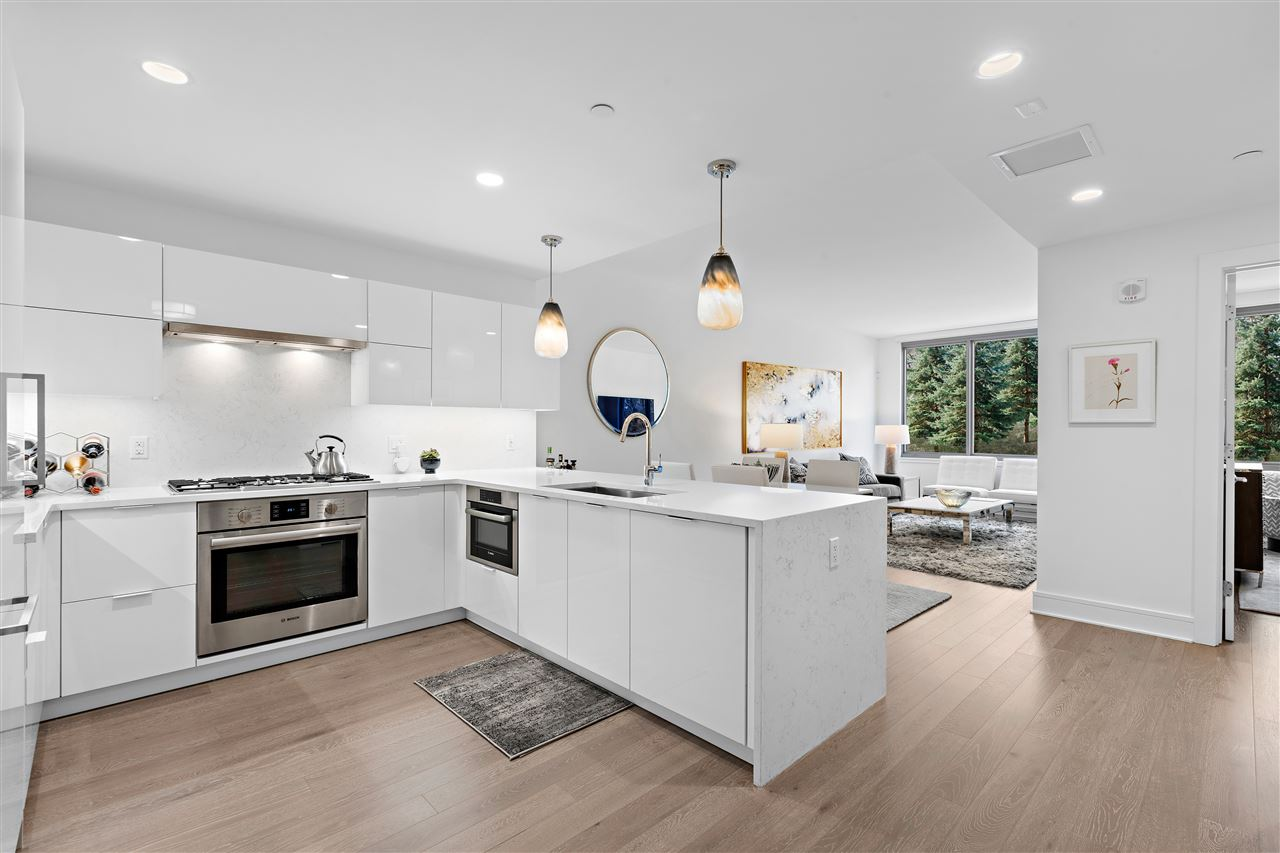 Live in the lap of luxury at Nine of the Hudson, perfectly located on the NJ Gold Coast waterfront! Move right into your beautifully appointed and spacious 1 bed 1 bath with parking. Enjoy an open layout with huge windows for the great western sunset light. The expansive kitchen includes Aspen quartz countertops, Pedini cabinets, Bosch appliances, Thermador refrigerator and Mitchell Gold infamous Jonas Brothers pendent. This home also features gleaming hardwood floors throughout, in-unit washer/dryer and generous closet space. The deluxe bath is finished with Carrera marble floors and walls, custom Italian Pedini vanity with a quartz countertop and Moen faucet and rain shower head. This premier new construction building boasts exceptional resort-style amenities including 24/7 concierge/doorman, a resident lounge, custom infinity pool, 6000 sq ft fitness center including a yoga studio, aerobic studio and weight room, 2 saunas, play area for our younger residents, community patio with fire-pits, bbq's, penthouse rooftop deck, wet-bar, and entertainment room. Other great area features include free shuttle to ferry and walking distance ferry, bus, River Walk Place shops and restaurants. The best PILOT program in the area! There is a 20-year tax abatement program!