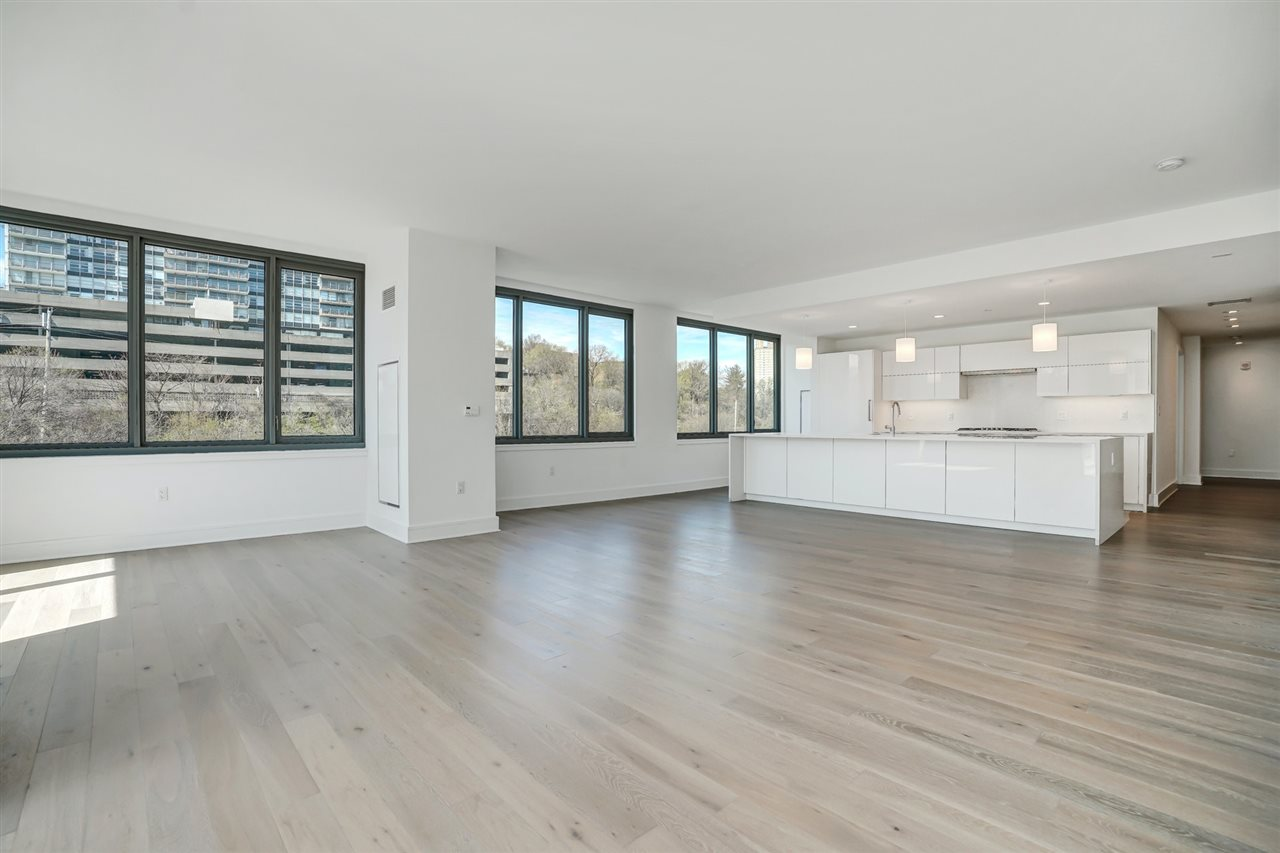 Endure in high-end luxury with the most desirable new construction building at Nine on the Hudson along NJ Gold coast area. This immaculate, southwest facing, 3 Bed + Den/ 2 Full Bath is sure to please with an open layout floor plan covering approx 2,000 sqft. When you enter the unit, step right into the modern kitchen featuring Aspen quartz countertops, Pedini cabinets, Bosch appliances, & Thermador fridge. The kitchen opening to the dining & living room area, flowing to the balcony makes this home perfect for entertaining! The master en-suite has a walk-in closet and the other generous sized bedrooms have a modern bathroom to share. Enjoy the very large den that could be used for any of your family needs! This home also features wood flooring throughout, in-unit W/D, oversized windows, & 3 indoor parking. Community offers views of NYC with 40,000 sqft of resort-style amenities: 24-hour doorman, fitness center, amenity deck w/pool & BBQ area, rooftop deck, shutttle to/from Ferry and a 20-year tax abatement you don't want to lose out on!