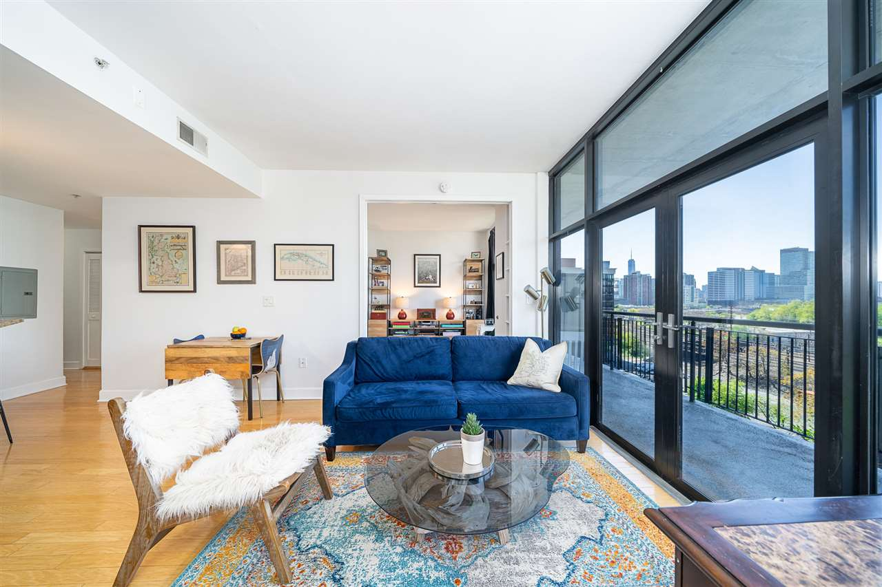 Sun drenched, south facing 2 bedroom/2 bathroom home just a few moments from the Hoboken PATH. This handsomely appointed home features an open concept floor plan, with high ceilings and floor to ceiling windows that lead to a private oversized terrace offering southern and Freedom Tower views. The kitchen is nicely equipped with stainless steel appliances, lots of cabinet storage, and granite counter breakfast bar. Split bedroom layout. Master bedroom has en-suite bathroom and fully customized walk-in closet. Second bedroom great as an office or nursey with beautiful brand new doors. Other highlights include washer/dryer in-unit, hardwood flooring throughout, generous storage, and parking for 1 car in oversized parking space in covered and locked garage. Building amenities include on-site building manager and daytime doorman, a fully equipped fitness center, additional communal deck space, steam room, sauna and a shuttle to the PATH. Conveniently located near Hoboken's new South West Park, NJ Transit Light Rail, PATH train, NJ Turnpike, Routes 1&9, shopping, dining and the Hudson River waterfront. DEEDED Garage Parking spot included in sale.