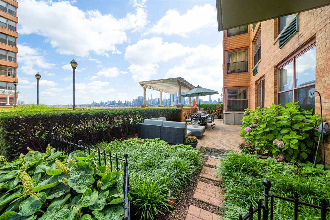Welcome home to the Hoboken Waterfront at The South Constitution! Premier location for this fabulous 3 bedroom 2 bath home with 1439 square feet of living space, a stunning 400+ square foot private patio with exceptional NYC views and onsite available parking- located in a full service doorman building with all the bells and whistles. This perfectly laid out home offers an open concept floor plan that includes a spacious wide open living room with a separate dining area that can easily accommodate your guests comfortably. Beautiful updated kitchen with plenty of storage, a full stainless steel appliance package, granite countertops with integrated sink and modern glass tile backsplash. This chef's style kitchen overlooks your dining area, making entertaining a breeze.  Master bedroom suite offers a full marble bath and a large custom walk in closet. Two additional guest bedrooms are both spacious with easy access to a second full bath, both with custom built in closets for additional storage. The crown jewel of this home is undeniably the private outdoor patio that offers plenty of space to host gatherings, dining al fresco or relaxing under the stars with unparalleled views of New York City's skyline-watch the sunrise or catch a glimpse of a rainbow and maybe even a firework display. This impressive home also provides wide plank hardwood floors, in home laundry, crown molding and a linen & pantry closet.  Come discover this highly sought after complex that offers a landscaped park like courtyard that is directly accessible from this home, 24 hour doorman, dual elevators, gym, on site garage rental parking and use of Shipyard pools (fee). Perfectly located in uptown Hoboken on the waterfront just steps to NYC transportation, 13th Street pier, waterfront parks and the shops and restaurants that dot Washington & Hudson Streets.  Please visit www.TheConstitutionHomes.com for more details, floor plan and 3D walk-through video.