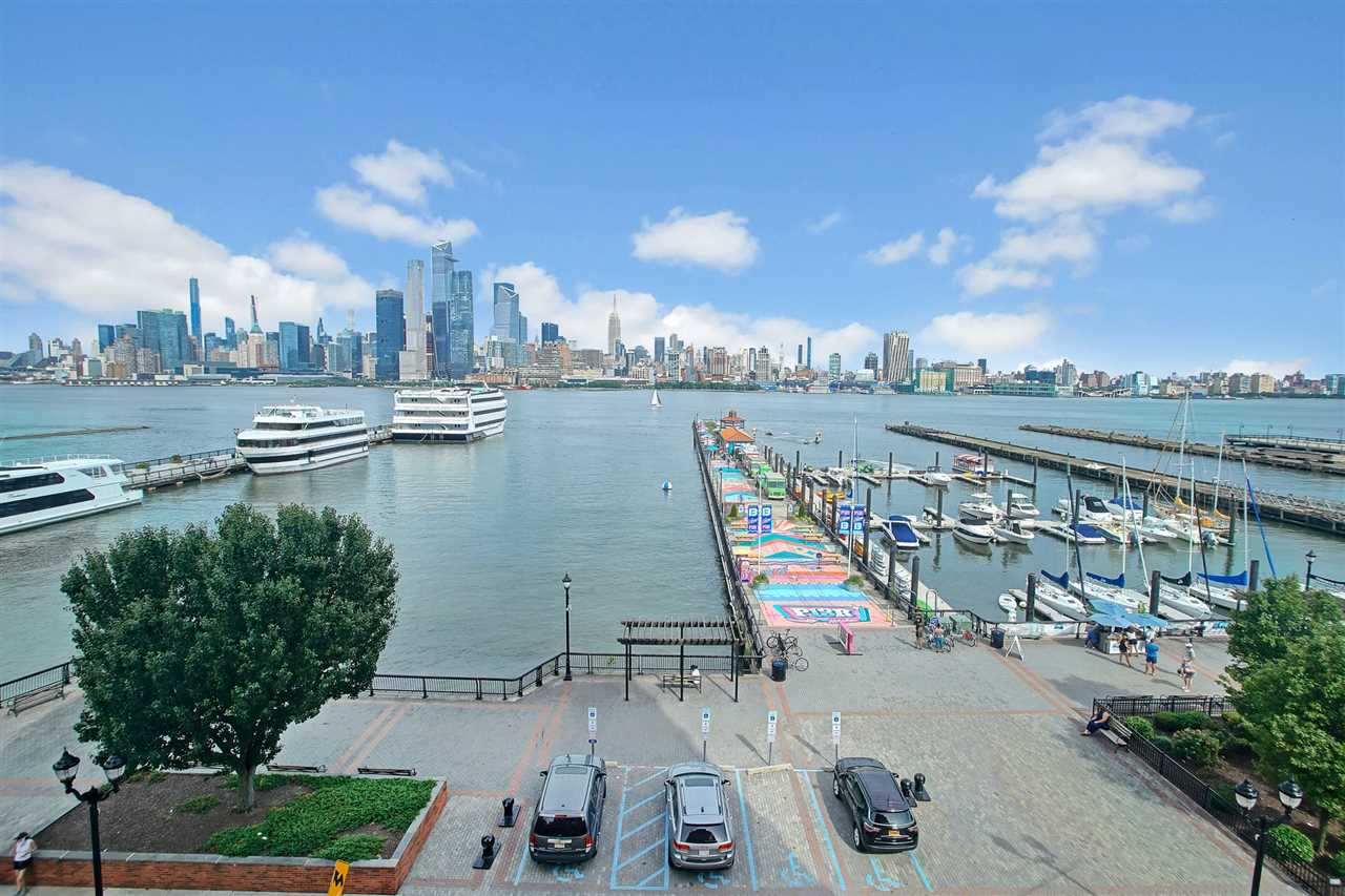Direct panoramic views of NYC & the Hudson River in this impeccable & meticulously renovated unit in a prime, Hoboken waterfront location.  Enjoy breath-taking views from every window.  Coveted corner unit with 3 bedrooms/2.5 bath filled with natural light and modern, top-of-the-line finishes and custom details.  Open layout in an exquisite designer kitchen facing unobstructed NYC views equipped with a package of appliances including a Wolf Stove & induction cooktop, SubZero refrigerator surrounded by elegant Quartz countertops and backsplash. Other features include Hunter Douglas electric blinds, Lutron lighting, spa-like bathrooms, Toto toilets, Hearth Cabinet ventless fireplace, ample closet space, well proportioned rooms and wide plank oak hardwood floors throughout. This building couldn't be more convenient to the ferry to NYC, shops, parks, marina, waterfront promenade, Pier 13 and restaurants.  24/7 Concierge, gym on 3rd floor, landscaped courtyard on 4th floor with children's play area, dual elevators, 2 outdoor pools (fee) and on-site garage parking (fee).  Enjoy luxury living with unparalleled NYC views in this perfect waterfront location next to everything this city has to offer.