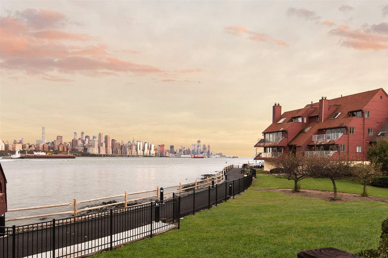 Beautiful 1800sf sun flooded 2 bedrooms 2 full baths at Roc Harbour with New York City & Hudson River views. Enjoy the views from your living area with wood-burning fireplace. Eat in Kitchen with skylight. Spacious bedrooms with hardwood flooring and plenty of closets. Separate laundry room. Take lovely night strolls along the waterfront promenade. Indoor garage included. Must see to appreciate!  Close to shops, restaurants, supermarkets Whole Foods, Mitsuwa