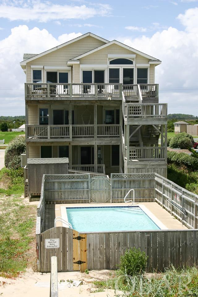 This 8 bedroom, 5 bath, 2 1/2 bath oceanfront home is truly a gem. Situated on a deep lot in S. Nags Head where the beaches are wide and uncrowded, this home offers an elevator, private heated pool, hot tub, game room and everything you would want in a home. Over $120,000 in seasonal rental income to boot! Elevation here is great - flood insurance is only $981 per year! $15,000 credit at closing for flooring updates.   Updates include, 2018- interior painted, professionally decorated, new bedding, 1 new HVAC unit, 2017 - 1 new HVAC unit, 2 new ranges. Other updates include hot tub, pool heater, dishwashers, microwaves, 3rd HVAC unit, tvs.