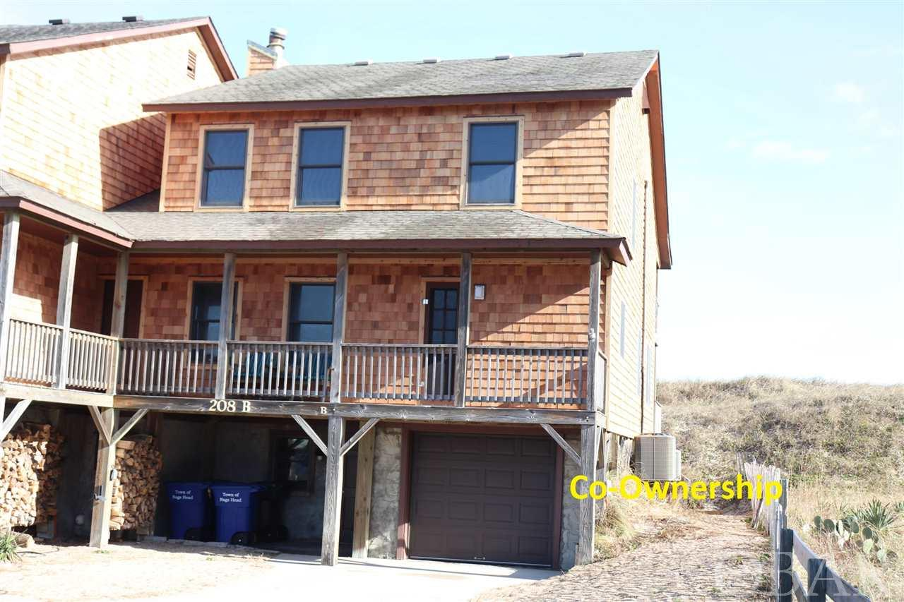 Duplex Co-ownership in Hawks Nest 15B. Own a 1/10 co-ownership or 5 weeks in this beautiful oceanfront Nags Head home. Walk out your door on your private access to the beach and enjoy the ocean. Every year the weeks rotate so everyone can enjoy winter, fall, spring and summer in their home. Hassle free, care free living is yours because the association dues pay for all expenses - taxes, insurance and utilities. Beautiful Ocean Views. Tastefully furnished 4 bedrooms, 3 bath, laundry area, outdoor shower, grilling area and garage with storage. Decks front and back with expansive views.  What a great opportunity to vacation in an oceanfront home at a fraction of the cost. Owners may rent the weeks they chose not to enjoy themselves. **Scheduled Weeks for 2019** 4/5-4/11; 7/19-7/25; 10/11-10/17; 12/27-1/2/20; 1/10/20-1/16/20