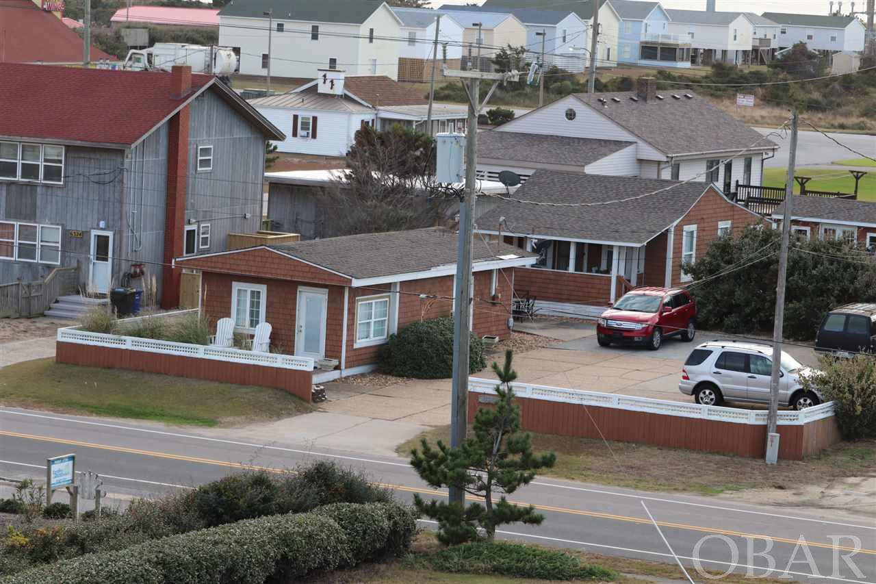 Two-home cottage court. The charm of old Nags Head remodeled with modern convenience in 2007. The 1st cottage nearest the ocean is a one-bedroom, one-bath home.  The 2nd is a two-bedroom, one-bath home.  Both are located on a large 11,039 square foot landscaped lot with fence, storage shed, and outside shower. The best feature of this property is Location, Location, Location! Just south of, and a very short walk to, the Forrest St. beach access with outdoor shower facilities, access ramp, and lots of parking.  Other nearby attractions include Tanger outlet mall, restaurants, fishing piers, Nags Head Golf Links, Town of Nags Head sound front park, mini-golf, go-cart track, Adventure Park and Jockeys Ridge State Park.