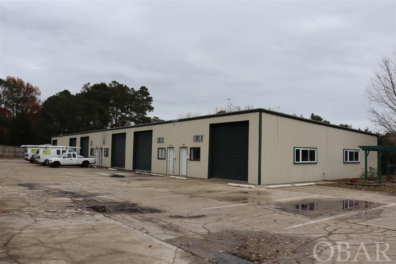 Six 1400 sq. ft. warehouse/office units for a total of 8400 sq ft. Concrete flooring, metal building, plumbing, 200 amp electrical with 220 available. 12-ft roll-up doors and up to 14 ft ceilings. Each unit metered separately. Great opportunity for owner/occupier or investor. Convenient location near Kilmarlic on Hwy 158. Two units currently on a month-to-month lease.  Owner financing available at a very favorable rate.  1 Mile from Water park and 4 miles from Wright Memorial Bridge to Kitty Hawk.  Current owner wishes to sell as one building, potential for new owner to condo building and sell units separately if desired.