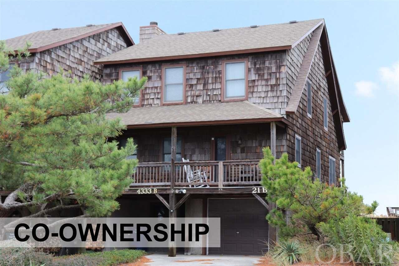 Easy, care free, remodeled and all inclusive oceanfront Co-ownership. This Duplex in Hawks Nest III covers all your needs. Own a 1/10 co-ownership or 5 rotating weeks in this beautiful oceanfront Nags Head home. Walk out your door to the beach and enjoy the ocean. Every year the weeks rotate so everyone can enjoy winter, fall, spring and summer in their home. Owners do trade weeks as well to fit their schedules with other owners. Hassle free, care free living is yours because the association dues pay for all expenses - taxes, insurance, cable, linens and all utilities. Beautiful Ocean Views from living room and master bedroom. Tastefully furnished 4 bedrooms, 3 bath, laundry area, outdoor shower, grilling area and garage with storage and owners lockable storage area. updated Master boast a huge jetted tub and separate beautiful custom tile shower and dual vanity. Decks front and back with expansive views. Spacious open floor plan.  Updated kitchen including granite, stainless and new appliances.  Open living area. What a great opportunity to vacation in an oceanfront home at a fraction of the cost. Owners may rent the weeks they chose not to enjoy themselves.
