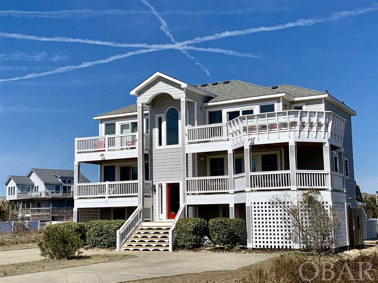 This impeccably maintained 8 bedroom, 8 1/2 bath home is located at the end of a quiet cul-de-sac in Section A of Ocean Sands which offers large homesites, a private uncrowded beach access and some of the widest beaches in Corolla. 7 bedrooms have attached bathrooms, 3 bedrooms have private decks, 2 living areas and a game room offer plenty of room to spread out. The pool and hot tub make this home a must see.  Updates include: 2019 -Air handler/heat pump, lower level; 2018 - bedroom tv's, dryer; 2017 - carpet, microwave; 2016 - top floor family room furniture & tv; 2014 - Refrigerator, stove/double oven; 2013 - Top level HVAC, washer; 2012 - 2 dishwashers ; 2010 - Hot tub, continuous flow hot water heater