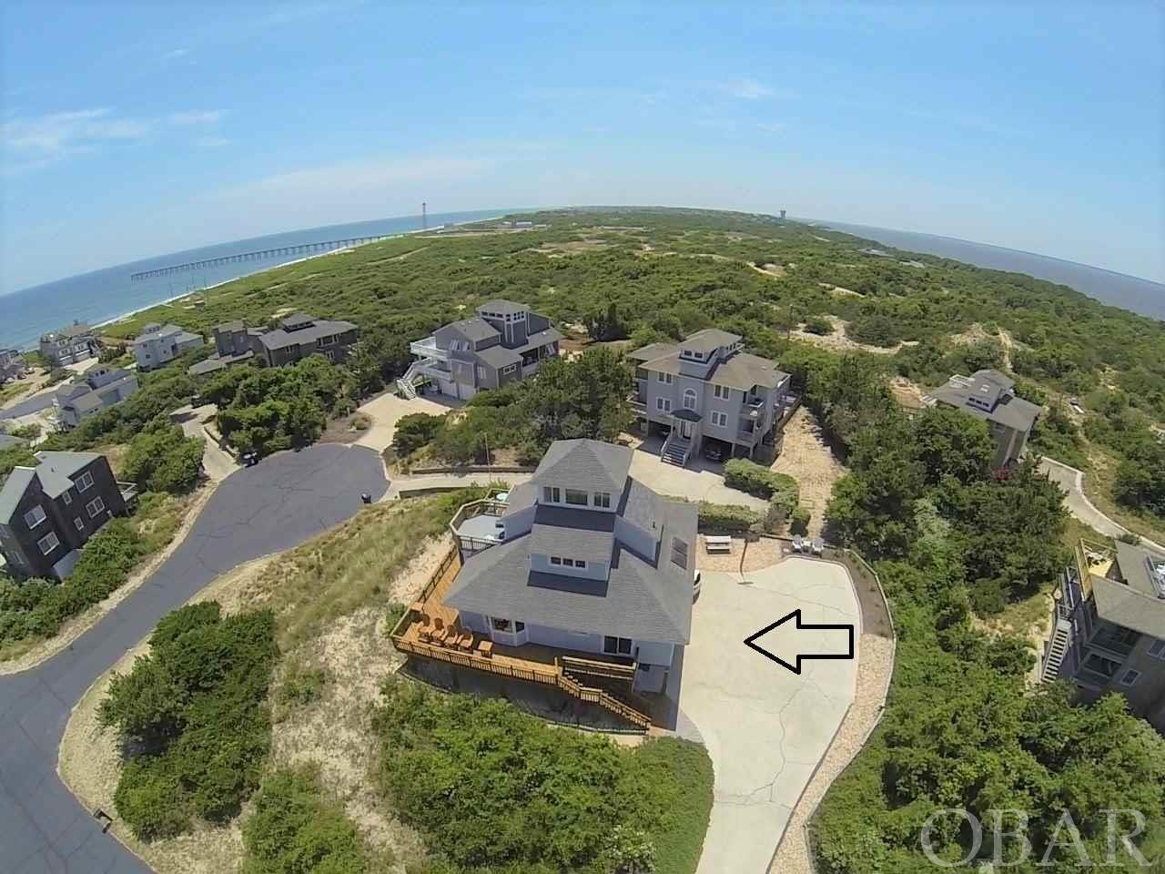 Perched high on a hill, this 4 bedroom, 3 bathroom home offers spectacular ocean and sound views and the beach access is only steps away. You will love the panoramic sunrises and sunsets that you can see from the shipswatch of this gorgeous home. The second floor features an open concept living room, dining room and kitchen that has great ocean views. There are also 3 bedrooms, 2 bathrooms. One bedroom has a private bath and deck access. The third floor offers a huge bedroom with private deck, bathroom and sitting area. The ocean views are amazing! On the 4th floor you will love the shipswatch which provides phenomenal 360 degree ocean and sound views. Shipswatch would also be perfect for a home office with privacy and a quiet atmosphere. Just across Duck Road from Osprey is Nor'Banks Sailing & Watersports and The Village Table and Tavern where you can enjoy lunch, dinner or both. Just minutes away in Duck Village are unique shops, inviting restaurants, sound front boardwalk and the town park with play ground, live music,Yoga on the green, festivals and more.