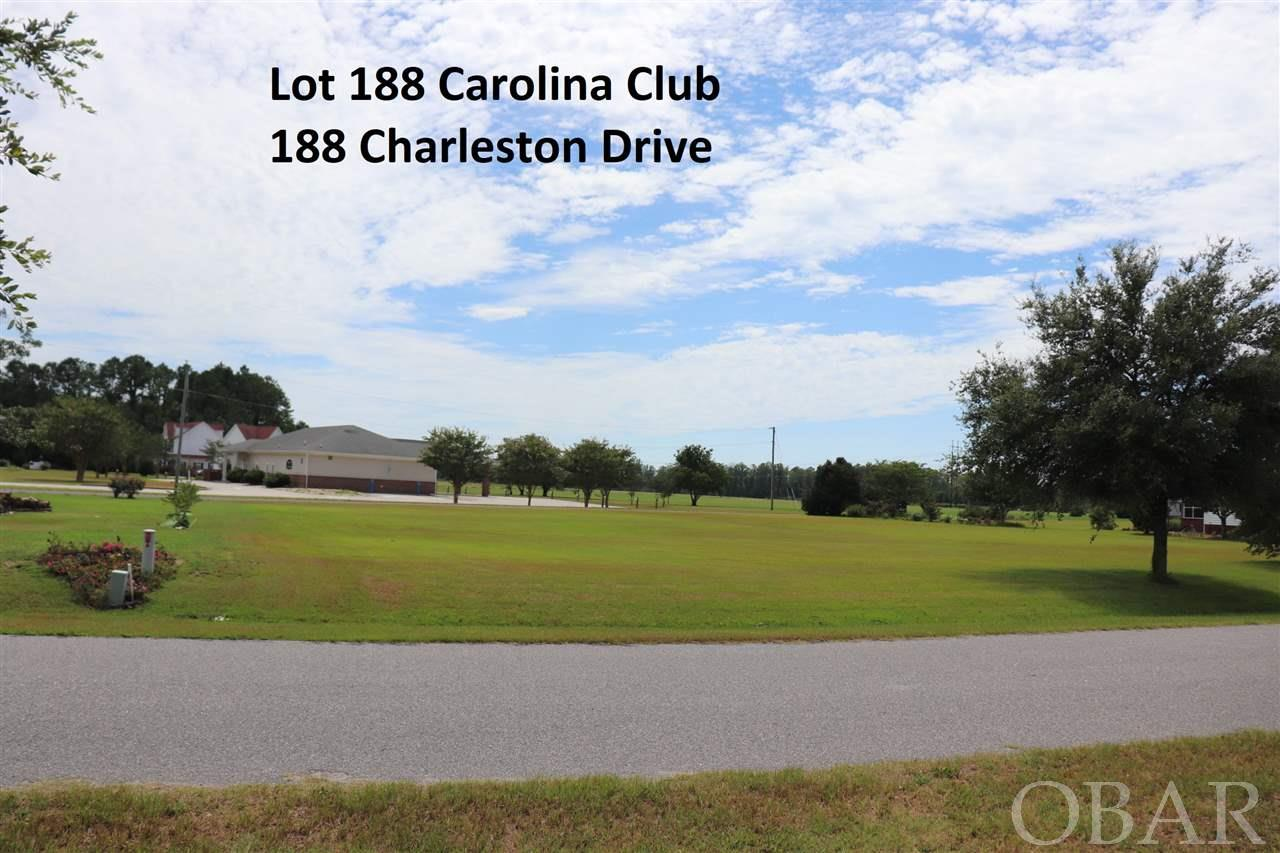 Large cleared building lot in the Carolina Club. Golf, marina, boat ramp, park, tennis and Community pool. Build your dream home in a beautiful amenity filled community. Manicured nature at it's best with plenty to enjoy.