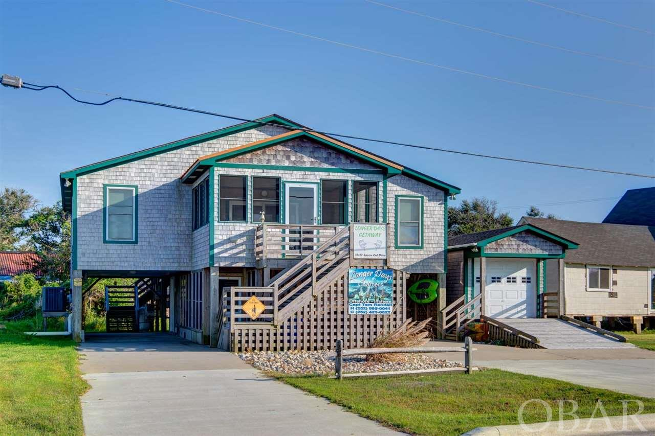If you are looking for a vacation home or an investment property, you need to see this great semi-sound front home located next to 'The Marlin Club'  This spacious 3 bedroom, 2 bathroom home boasts an open living area all with ceramic tile, built-in entertainment center, classic kitchen cabinets and plenty of extras!  A spacious screened porch is located off the living area with sound views and plenty of room for a gathering.  Downstairs you'll find plenty of storage, outside shower, fish cleaning table, and screened porch with hot tub.  Double parking underneath the home, an enclosed ramp garage area, built in gas grill, and a dumbwaiter are all bonuses for this well kept home.  The home is being sold unfurnished so you have the opportunity to make the home yours.
