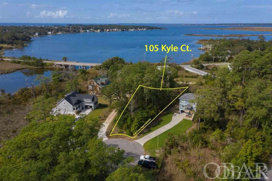Large building lot with beautiful sunset and sound views.  Community boardwalk and dock provide sound access.  Perfect for kayaking or world class fishing and crabbing.