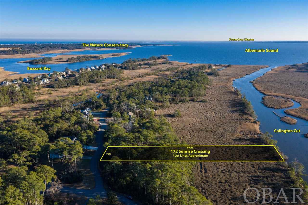 Beautiful large building lot located in Sunrise Crossing on the cut. This property features beautiful sunset, canal, and sound views and direct water access. Build your own dock or Sunrise Crossing offers a community boardwalk and dock to provide sound access. Perfect for kayaking or world class fishing and crabbing. Build your custom dream home and enjoy all the OBX has to offer.
