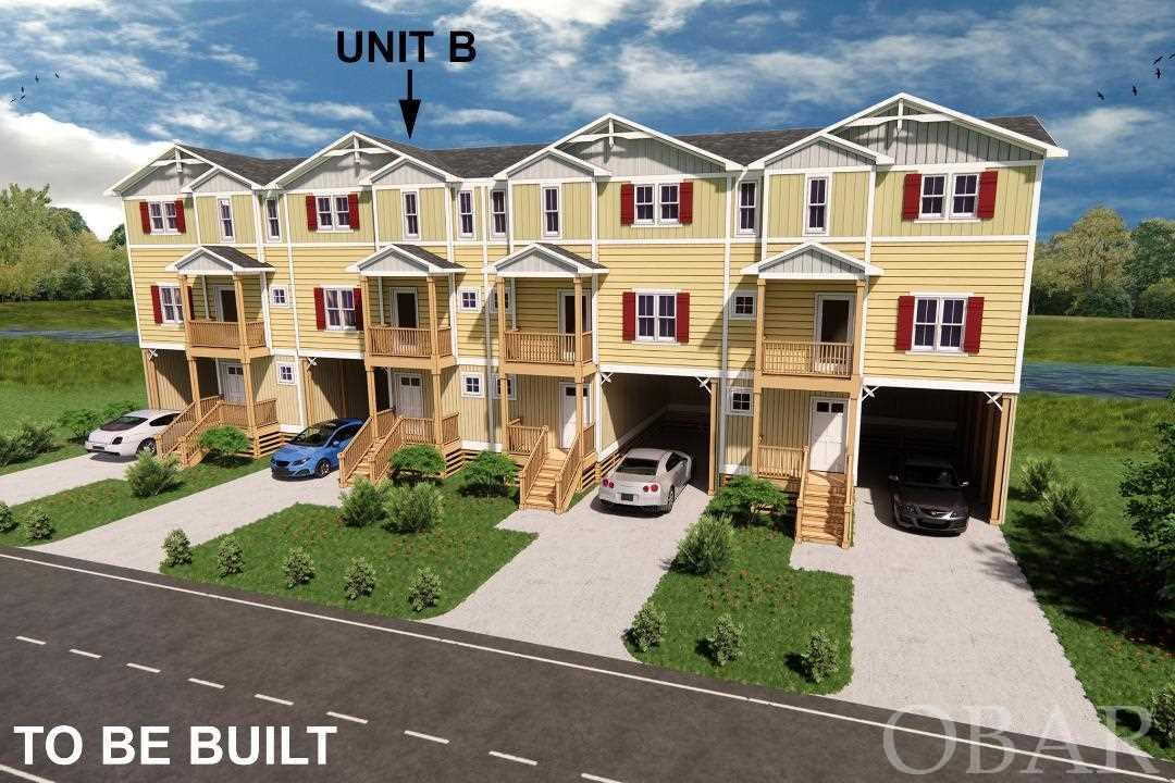 New construction. New townhouses are coming to Colington Pointe. The Harbor House, one of our most popular single-family designs for a reverse floor plan with top floor views, has been redesigned by Florez & Florez as a townhouse. This floor plan allows for 3 master bedrooms.  The top floor has fabulous views of saltmarsh, canal, and sound. Amazing bird watching. A half bath, dining area/great room, and a granite and stainless kitchen.  The grand master complete with master bath, over-sized walk in closet and private deck are on the mid-level with an additional master and foyer.  The ground floor has the third master, large wash and utility area, storage, and outdoor shower.  Reserve this house today and make your selections on finishes.  Colington Pointe is the premier waterfront community in Kill Devil Hills. With quality R.M.Saunders construction and Florez Design the Harbor House is a winning combination. Colington Pointe offers Large clubhouse with a full kitchen and multiple baths, outdoor pool, boat ramp, waterfront boardwalk, affordable luxury living close to the sound and ocean. All pictures shown are of a similar model. HOA is only $1,900 a year