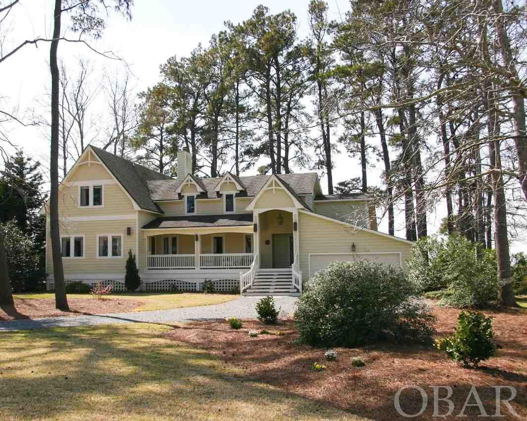 This gorgeous soundfront 5 bedroom, 5 1/2 bathroom home has spectacular sound and sunset views! It has been excellently maintained and used sparingly as a second home. In 2002, approximately 2,000 square feet of living space was added and the home was totally renovated by Randy Saunders, one of the Outer Banks top builders. Updates include a 22' boat lift, jet ski lift, pier and hot tub (2009), 2 new HVAC units (2015), a new garage door (2017) 2 new hot water heaters (2017) and central vacuum system (2017). This home features 2 fireplaces, large bedrooms, 2 living rooms, tons of storage and Anderson windows and sliding glass doors. There is room for a pool should you want one.