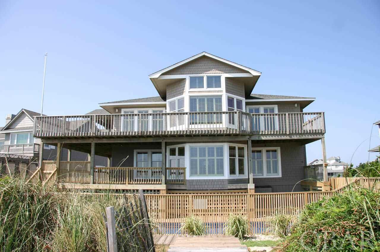 Outstanding oceanfront home with new private pool, beautiful wide renourished beach, new septic system for 6 bedrooms, new driveway & landscaping. Only used as a second home. Within 150' of the undeveloped land of the Army Corp Research Pier with quiet,uncrowded beaches. Fantastic views of the ocean and breathtaking sunset views from the deck off the Ships Watch.  Extensive renovations and upgrades over the years make this a must see beach getaway. Stunning kitchen with beautiful cabinetry, glass tile backsplash, granite & caesarstone countertops,  Kitchen Aid appliances, ULine wine cooler. Master bath(upper level) upgraded with cabinets, sinks,fixtures,granite tops. Several windows & doors replaced/upgraded. New HVAC in 2018 for the mid & top levels with 10 year Trane warranties. Elevator, central vac,hardwood & tile floors, juniper wood walls and wainscot,spacious closets,large game room with pool/ping pong table, two garages with finished interiors & storage closets.  Beach nourishment project increased annual taxes for 5 years. 4 years have been paid.    See Brokers Notes for info on Osprey/Sea Ridge community pool.