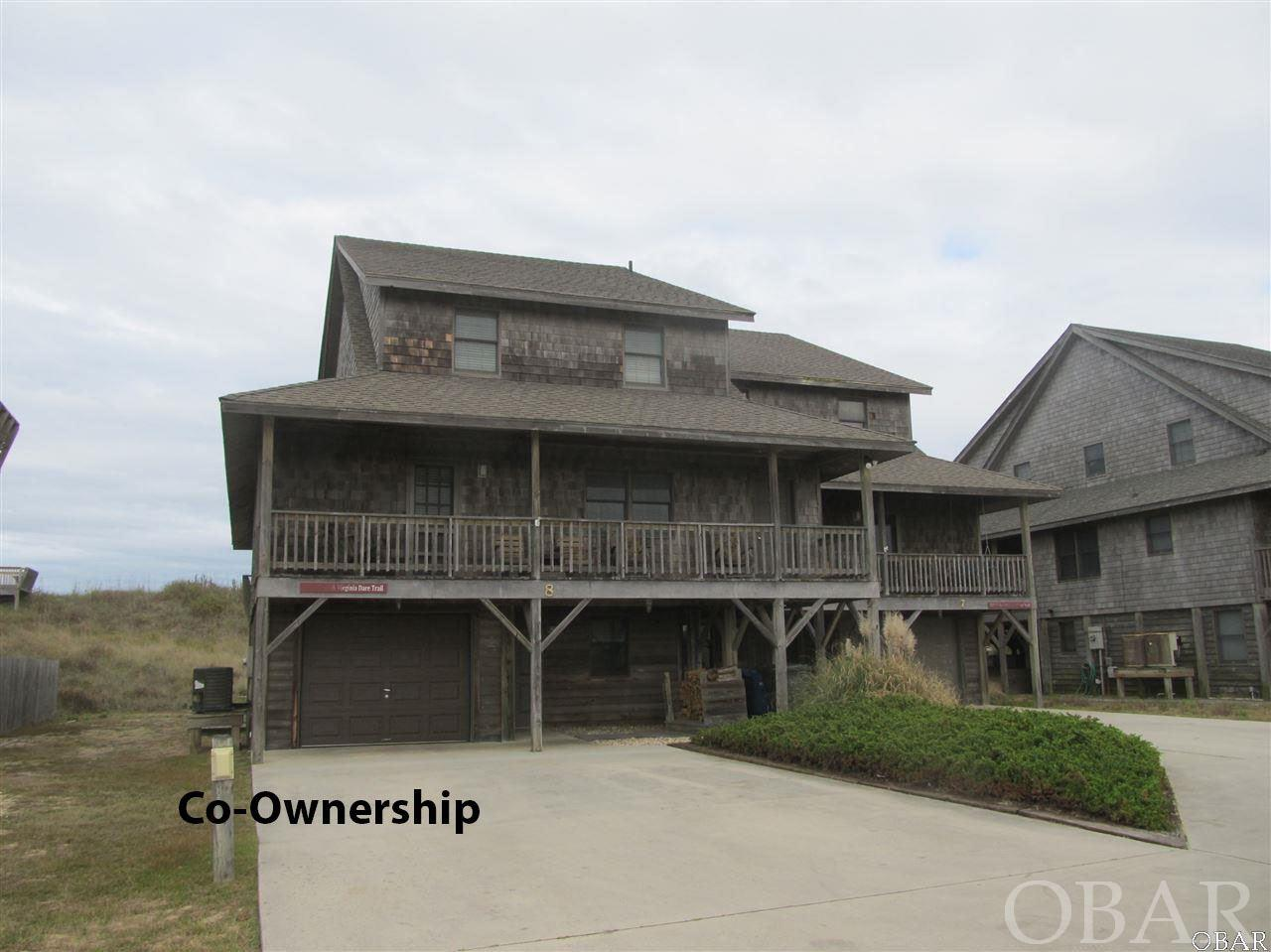 Easy, care free, and all inclusive oceanfront Co-ownership. This Duplex in Five Seasons covers all your needs.  Own a 1/10 co-ownership or 5 rotating weeks in this beautiful oceanfront Nags Head home. Walk out your door to the beach and enjoy the ocean. Every year the weeks rotate so everyone can enjoy winter, fall, spring and summer in their home.  Owners do trade weeks as well to fit their schedules with other owners. Hassle free, care free living is yours because the association dues pay for all expenses - taxes, insurance, cable and all utilities. Beautiful Ocean Views. Tastefully furnished 4 bedrooms, 3 bath, laundry area, outdoor shower, grilling area and garage with storage and owners lockable storage area.  Master boast a huge jetted tub and separate shower Decks front and back with expansive views.   Spacious open floor plan in kitchen and living area.  What a great opportunity to vacation in an oceanfront home at a fraction of the cost. Owners may rent the weeks they chose not to enjoy themselves. **2019 scheduled weeks for this ownership:** 5/17-5/30; 8/16-8/22; 11/8-11/14; 2/21/2020-2/27/2020