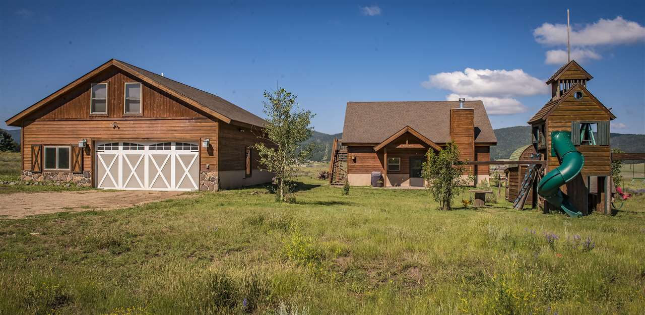 This is a unique find!  Just minutes from the ski area but outside the Village.  Over 6 acres of land and views all the way around.  House was built in 2008 and is 3 bed 3 bath with a detached 1428 sq ft garage/workshop with income producing apartment above.  Potential horse property as it is flat and does have a small year round stream located on the 6 acres.  Perfect for a working family with area to run and enjoy the outside.  Home has radiant in-floor heat and radiant baseboard upstairs or for the full-time resident a log fed boiler system.  Green house on the acreage for those interested in gardening.  Lots of sun and flat drive for easy access.  Whimsical play station for the kids will stay with the house.