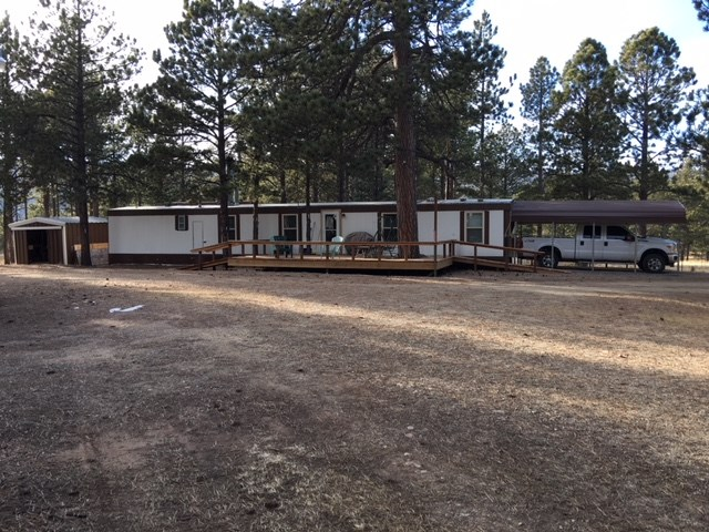 14x70 mobile home in El Bordo Trailer Park. Recently updated 2 bedroom, 1.5 bath with new decks front and back, steel storage building, covered carport. Right off 434. Great for a vacation home!