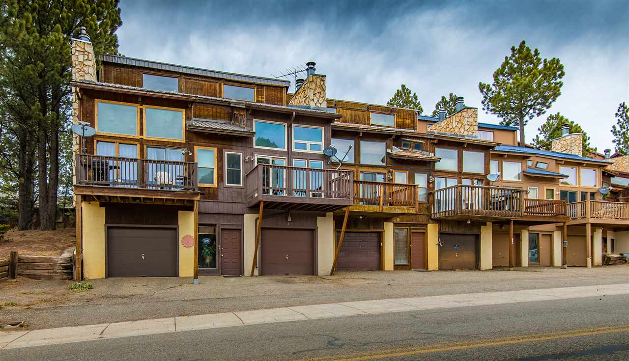 This townhome is situated about a block from the ski area, with some of the best views of the ski area available.  One of the only complexes that does not have complex HOA dues.  Rare to find a condo with a garage and extra storage.  Great for Mountain Bikers or skiers to just walk to the trails.  one main level bedroom and bathroom and one large loft bedroom and bathroom upstairs. In unit washer and dryer located upstairs near loft.  Recently updated .  Very nice stone accented fireplace in main living area. lots of windows and tall ceiling in great room. Deck on front to enjoy watching skiers come down or to view torch light parades. Enclosed stairs to main floor.