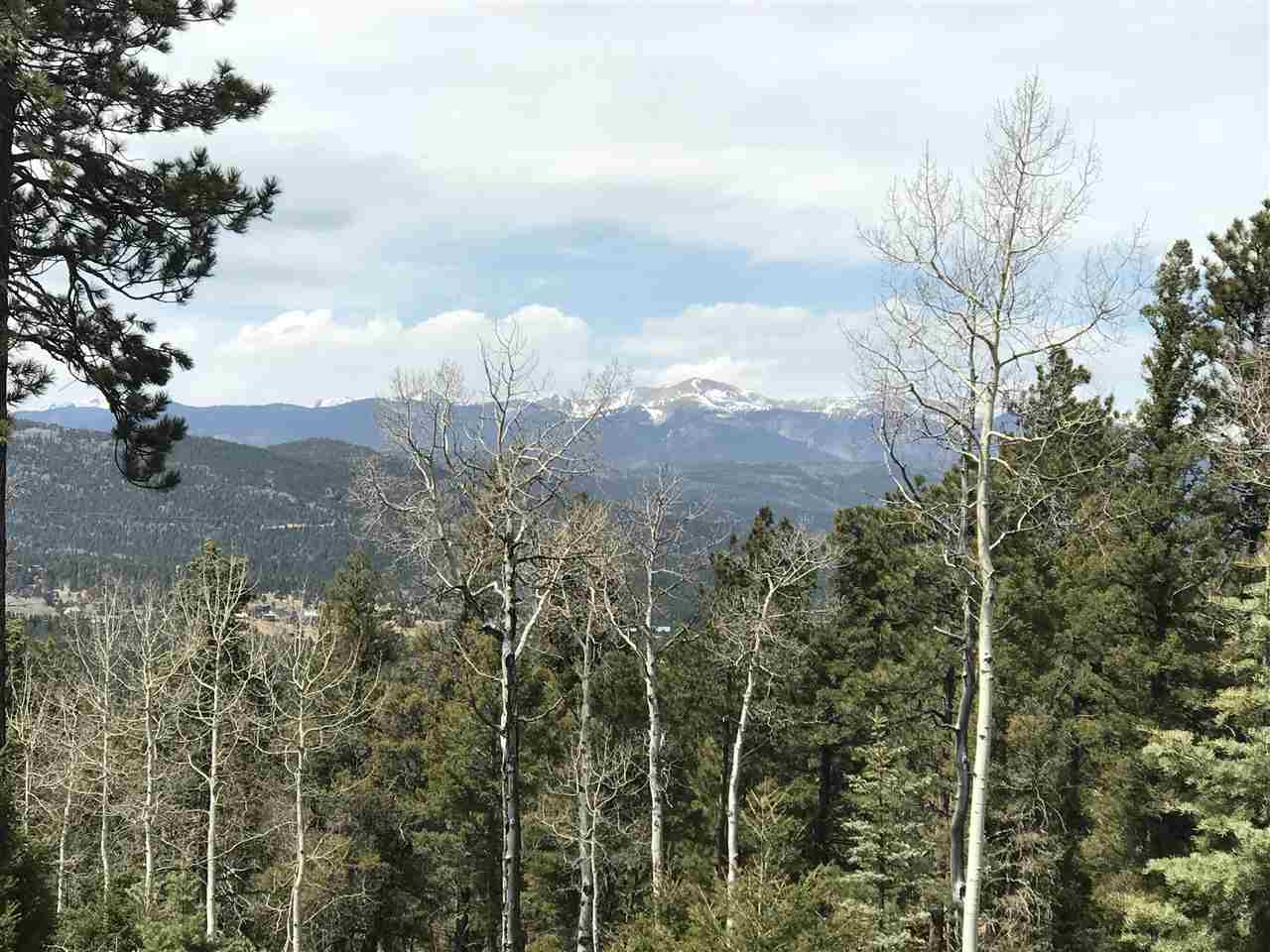 Views, views, views!  Beautiful Wheeler Peak view from a gently sloping cleared lot on cul-de-sac with mature trees.  Just up the road from Monte Verde Lake and close to town, golfing and skiing.