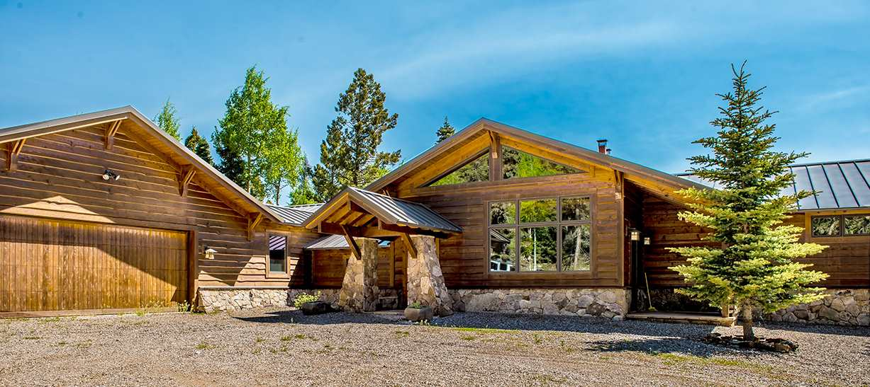 """What an amazing property! Set high on 32 acres in the Aspens subdivision, known for some of the best views in Angel Fire this property backs up to National forest and is a rare find.  Built by Sutton Construction in 2007 and meticulously cared for by the owners it is in immaculate condition.  From the moment you enter the gate and see the driveway lined with tall quaking Aspens you realize you're about to see something that is truly """"one of a kind"""".  Over 3,000 sq. ft. of well thought out floor plan holds 4 bedrooms and 3 full bathrooms all in ranch style architecture. The Great Room contains a floor to ceiling Anasazi stacked stone fireplace with custom wrought iron screen, fire tools as well as all door hardware made by an artist in Taos.  Almost all light fixtures in the house were custom made by an Austin Tx. artist   The dining area showcases the acid stained concrete floor and allows for large family gathering.  Standing in the kitchen you are able to gaze out the wall of windows to see elk and other wildlife walking by. The Great Room flows onto the deck which also has a rock fireplace and breathtaking views perfect for entertaining in the summer.  Master bedroom is on south side of the house and is situated as to always wake up to a view.  Master closet is large and functional with built in shelving and Master bath is his and hers style adorned with custom rock light fixtures.  On the north side of the house you will walk down Western Red Cedar board and batt lined hallways that give you a cabin like feel and lead you to three guest bedrooms.  One bedroom has it's own bath and two other guest bedrooms share a bath accented with a natural timber vanity.  Laundry and large three car heated garage also are found on the north side. House is heated by in floor heat which keeps all the floors cozy to the touch in the winter. The owners asked for the house to have a sloping wayne's coat of moss rock found on the property to capture the grand lodge feel. The seller """