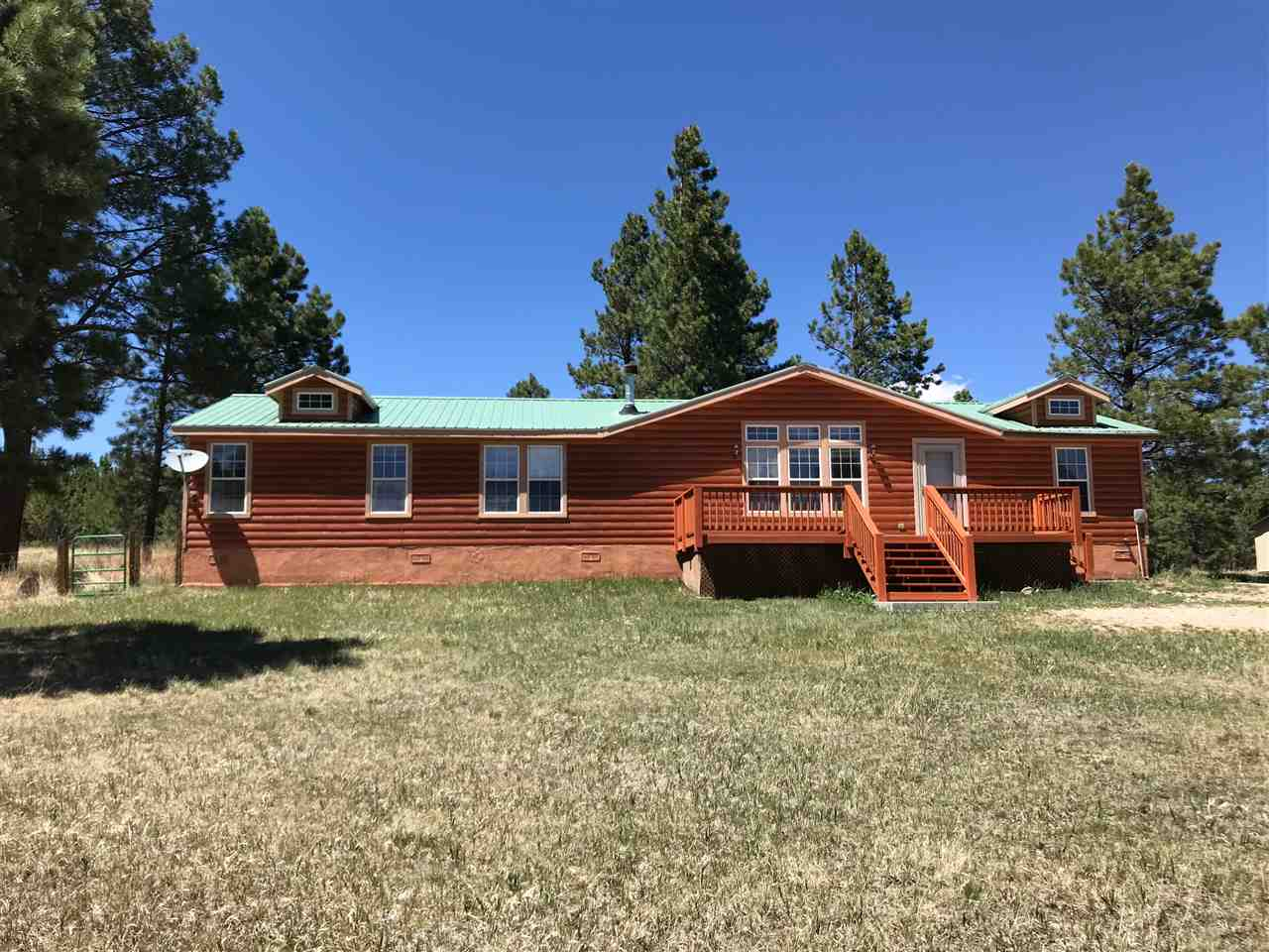 Freshly painted and all new carpet in this 3 bedroom, 2 bath home with views of the Angel Fire Ski area.  Easy access driveway, located off the Resort, no Resort dues.  Log siding and upgrades with a great floor plan.  Storage shed in the backyard.  Just minutes to ski and golf.