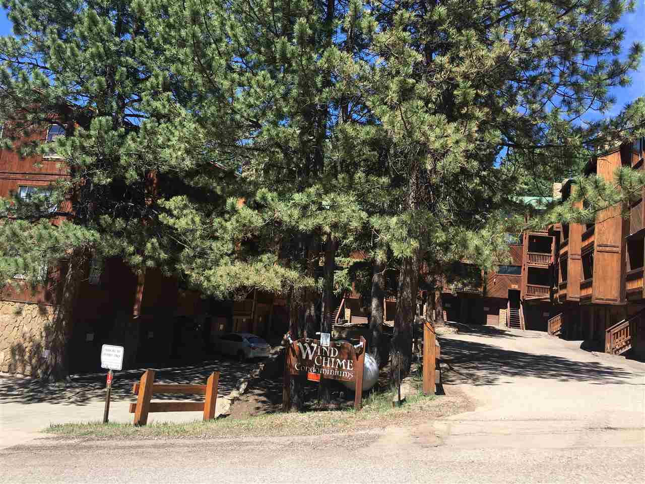 Unit 104 Windchimes is a bright 1 bedroom, 1 bath with a open floorpan in the kitchen / living room, and a 1 car garage.  In unit washer/dryer.  Just a short walk to the mountain biking and ski hill. Remodeled and ready for use.  Comes furnished. Enjoy all the amenities that Resort membership allows. Walking distance to restaurants and all the events that the Resort does on the ski hill and during the Summer.  Come relax and enjoy the mountains.  High speed internet to the unit which you won't need because you will be relaxing. Winchime HOA covers water, high speed internet, outside electric, outside snow removal, outside maintenance, cable and outside insurance.
