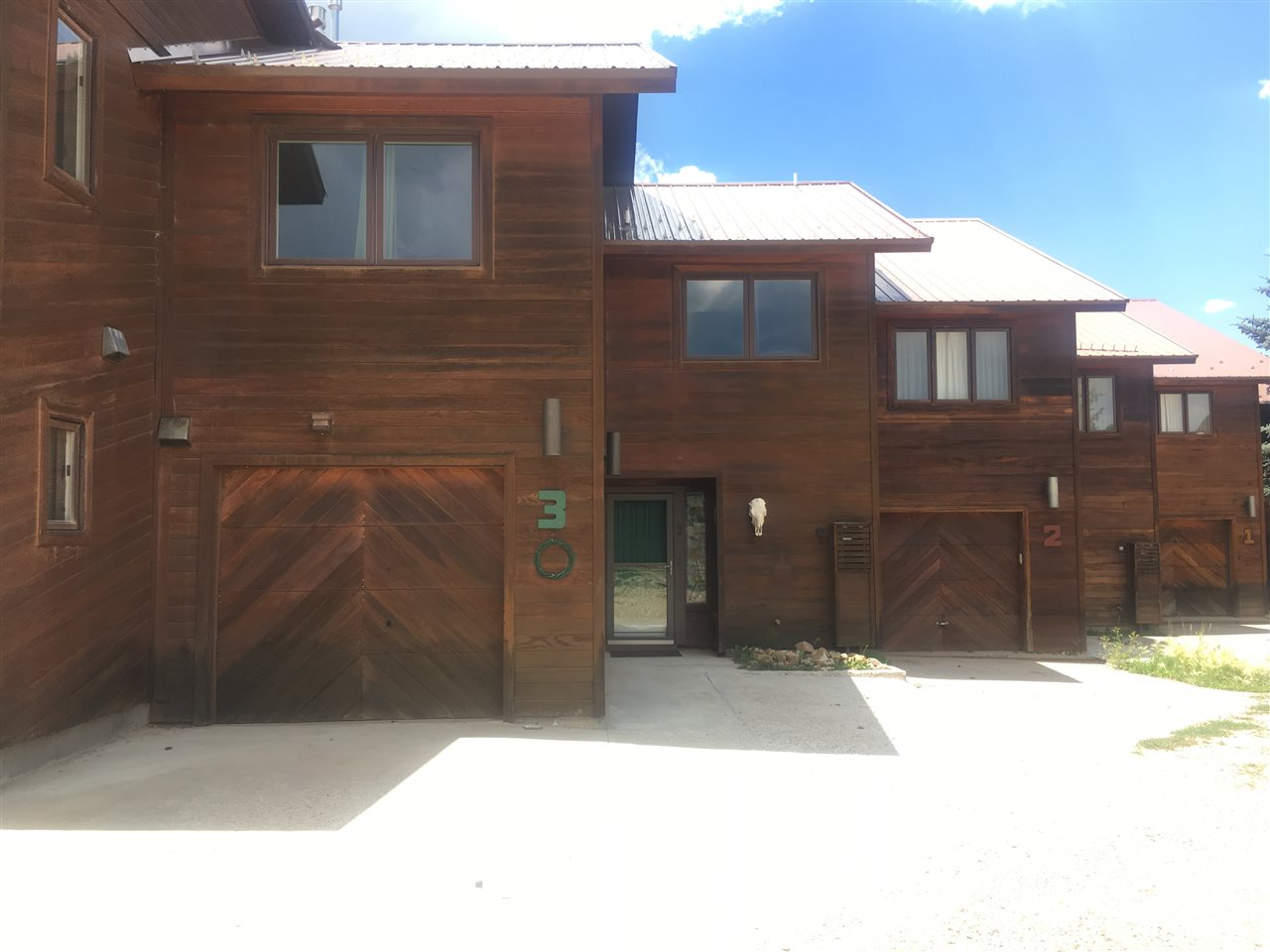Convenient location just off North Angel Fire Rd, walk everywhere! This 3 bedroom, 2.5 bathroom townhouse is one of 7. This has a large living area with rock detailing fireplace. Great sun-soaked deck with views to the resort. Comes complete with a single garage for all of your mountain toys. No HOA fees.