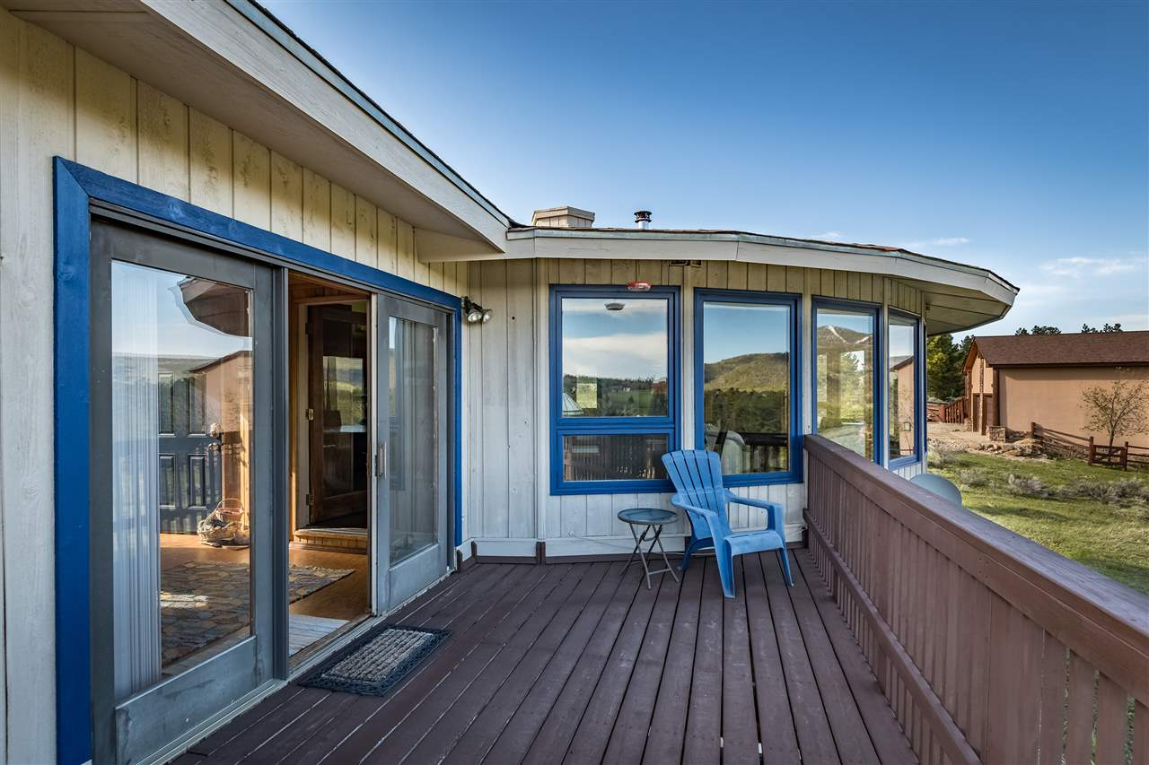 Live life in color! This cozy efficient, adorable house will welcome you home from the fairways and the slopes. It's bright and happy colors will make you feel instantly better! Sweeping views of the Angel Fire mountains, Golf/Nordic course and ski area are a highlight upstairs and downstairs through the large Pella windows. Passive solar gain, a beautiful Jotul wood burning stove, and a energy saving ceramic radiant heater keep the home toasty during the Winter. Two bedrooms and one bath upstairs, one large room with plenty of sleeping area plus a bath downstairs compile this 2200 sq ft of comfortable living.  The open downstairs area makes a terrific romper room for the kids.  Easy to host two or more families for a getaway.  Nice sized deck off the back is a great place to enjoy the elk and hummingbirds and just to relax.
