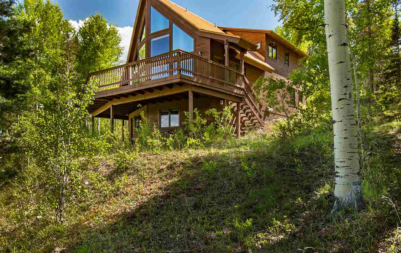 This home is tucked away in The Aspens subdivision which is known for its incredible views of the ski area and the Valley floor.  Set back from the road on a tree lined drive the house faces East and includes over 5 acres of thinned land regularly used by elk and turkey.  As you walk into the living area you are able to experience the wall of window views that have the ski area in its direct line of sight.  The living room is accented by aspen paneling and a large floor to ceiling rock fireplace to get that mountain cabin feel.  The kitchen is open to the living and has solid hickory cabinets and Sub Zero refrigerator.  All granite countertops and bar seating.  Large dining area to seat extended family and friends.  Main level holds two guest bedrooms and shared bath plus entrance to garage.  Upstairs is the master bedroom and study.  Master opens out to its own private deck and encompasses a large bathroom with his and her sinks. The study is gently removed from the master and includes a sitting area as well as desk space with fiber optic internet cable in place. The lower level is used as game room/extra living and bunk area. Laundry and full bath on lower level. In floor heat on lower level and hot water baseboard on upper levels.  Home has two car garage with easy access from driveway. Comes furnished, with a new septic system! A perfect place to melt into the scenery and relax!