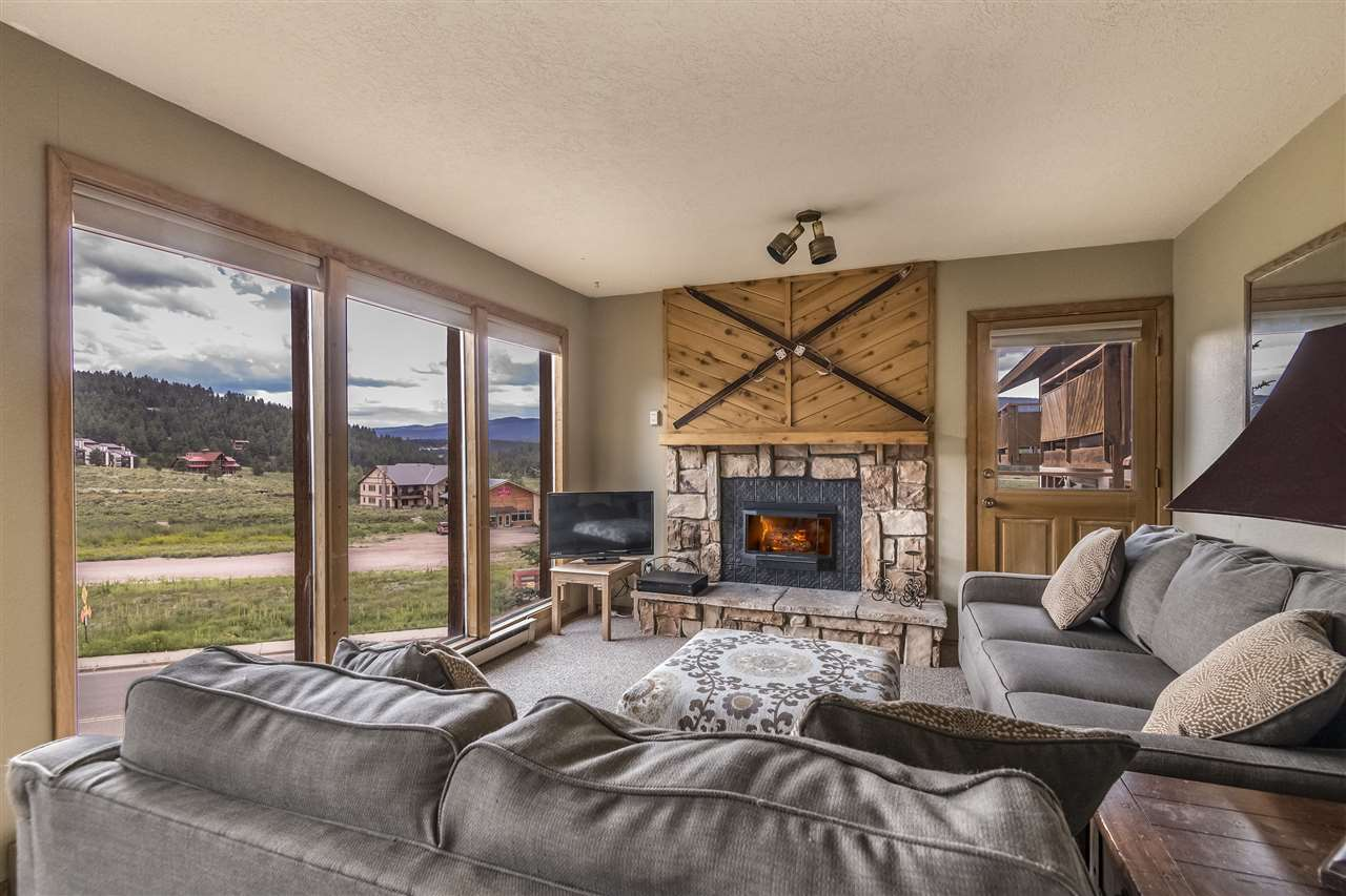Beautifully situated to look at the ski area and also have a view of Wheeler peak.   Guest bedroom and front deck look at Wheeler and living room looks at ski area. Two bedroom two bath with an extra, small room that could be a study or bunk bed area.  Living room filled with tall windows to accentuate the view.  Propane rock fireplace to sit and enjoy after skiing.  Locked outdoor storage next to front door to store skis and gear. Short set of covered stairs to front entry.  Easy access parking. Wsher/dryer in the unit.  Inside unit is all one level.
