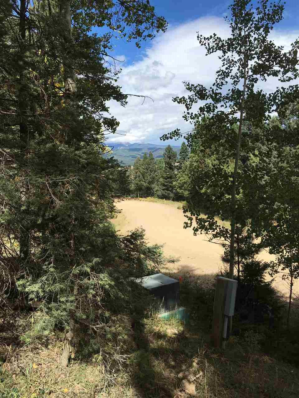 Close to ski area.  Some grade to property but location is key with this property. Beautifully treed.