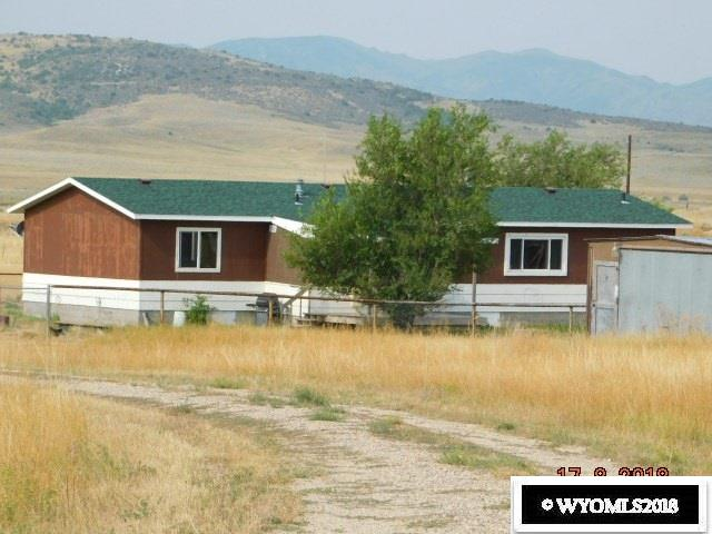 COUNTRY LIVING - 40 acres for horses, cattle or pets with view of mountains. New soffit and facia on the modular home  on foundation according to appraiser for current lender and current lender will make new loan to qualified buyer. Additional well drilled on back 20 acres for another  home and/or barn/shop. Property has horse barn, pipe corrals and water to corrals. NO ZONING NO COVENANTS. Call Shirley to view this home 307-359-0208