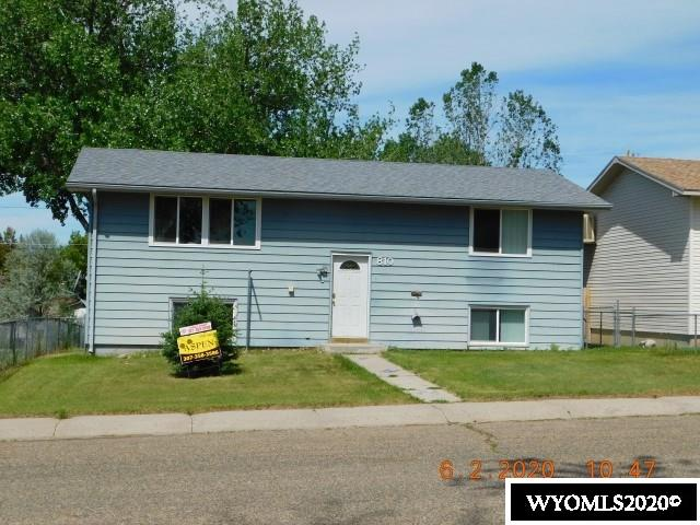 Great fixer-upper with 4 bedrooms (2 up, 2 down)  1-1/2 bath, chain link fenced back yard with storage shed and alley access.  Large living room upper level with very large family room downstairs. Family room has walk out access to back yard shaded by large cottonwood tree.  Large deck off the kitchen/dining room makes for great family gatherings and watch kiddos from the back deck looking into back yard. Very close to amenities: gas, food, eating out. Call Shirley at Aspen Realty to view 307-358-3586