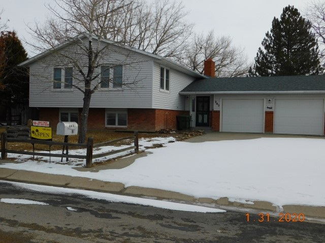 GREAT FAMILY HOME on corner lot for extra parking, plus 2 car garage, deck and concrete patio in back yard shaded by trees and shrubs for privacy.Open concept with large living room, dining room with built in china hutch and large kitchen. All these rooms open onto a large deck in back yard perfect for family  gatherings. Very close to schools, walking and biking path along the river.  Call Shirley to view 307-358-3586
